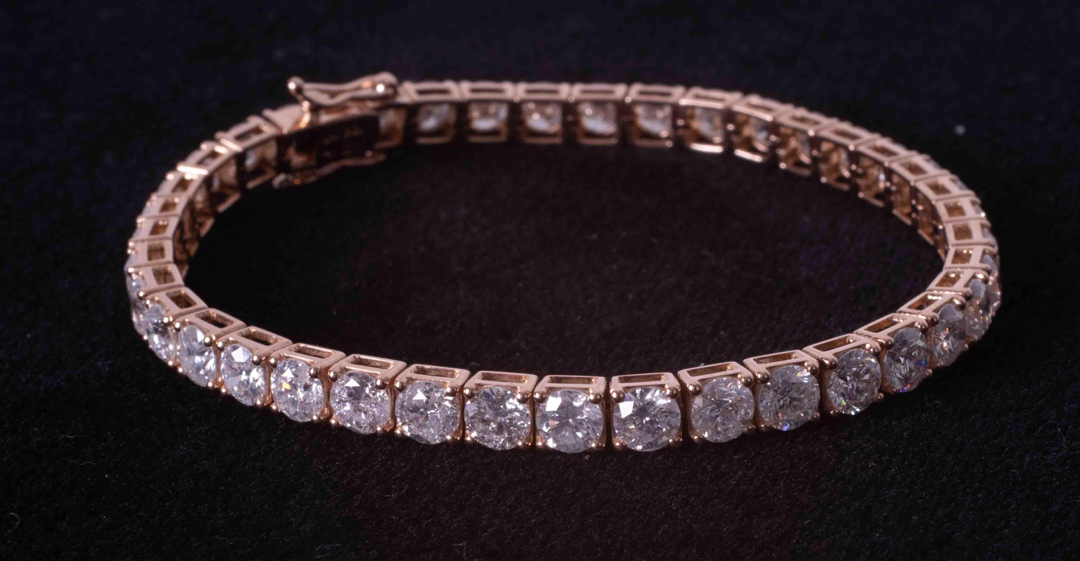 An impressive 18ct rose gold (stamped 18k) tennis bracelet set 39 round brilliant cut diamonds, - Image 2 of 4
