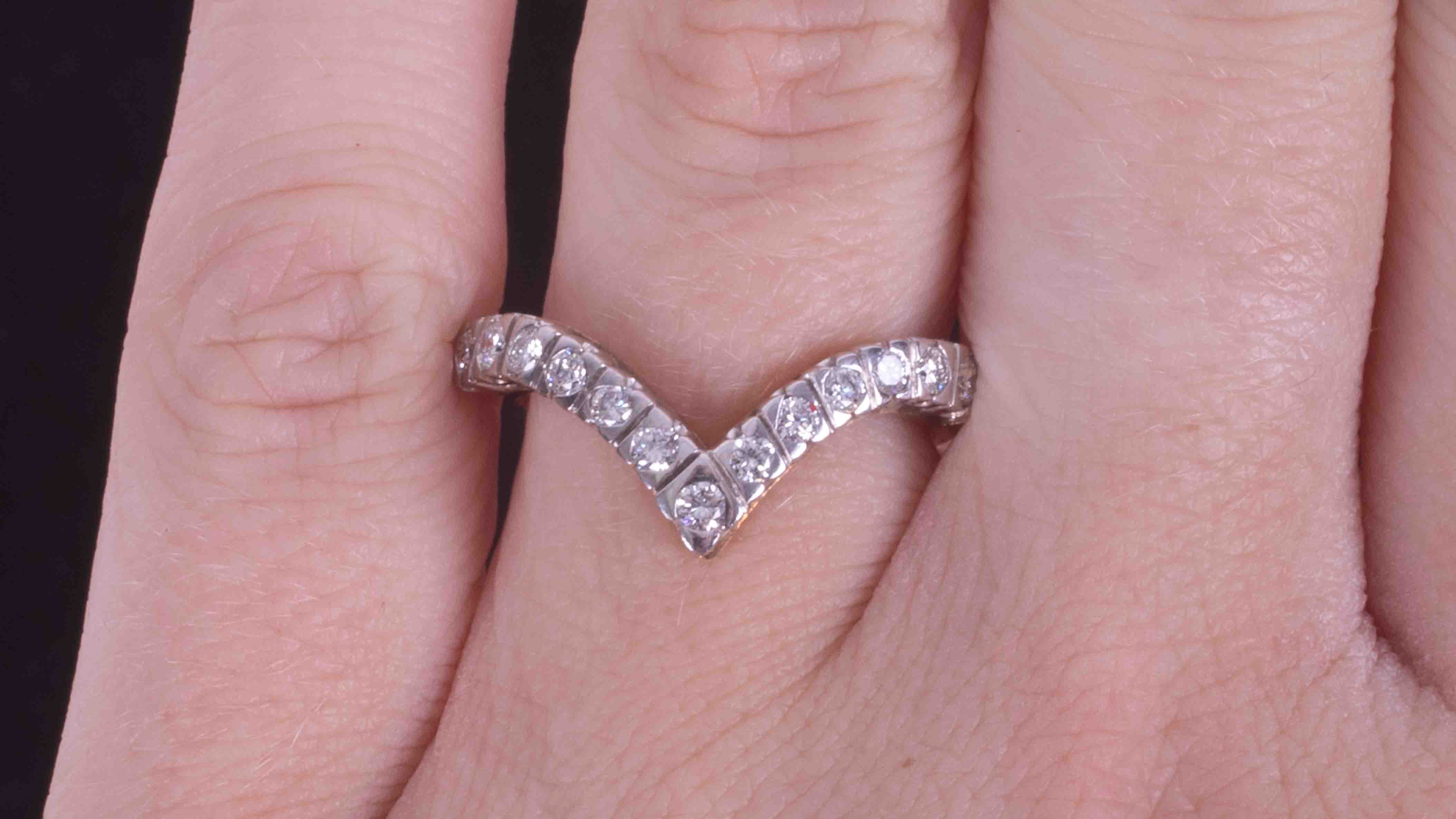 An 9ct yellow & white gold wishbone ring set with approximately 0.39 carats of round - Image 2 of 2