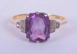 An 18ct yellow & white gold ring set with a fancy rectangular cut Amethyst, approx. 3.80 carats with