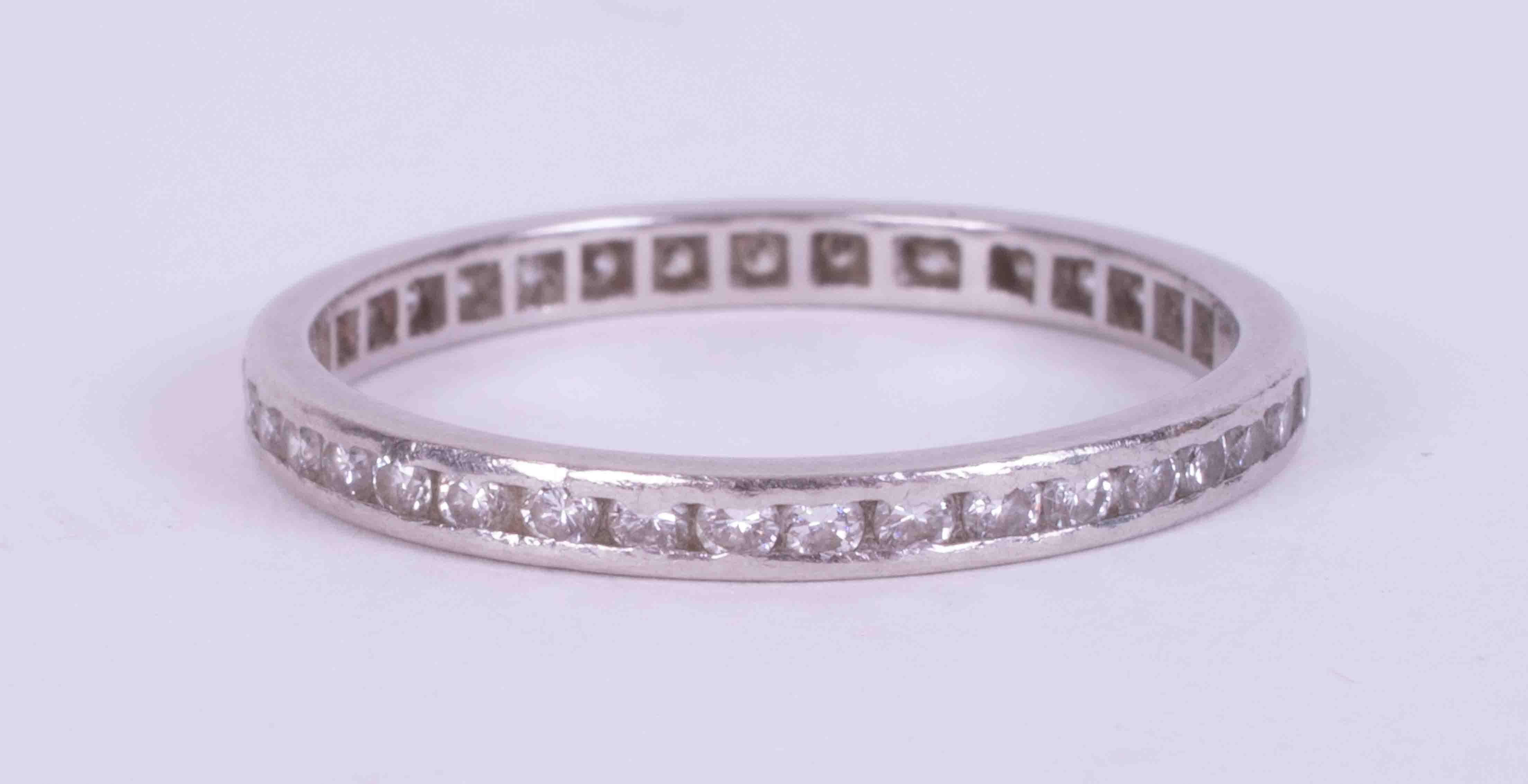 A platinum fine full eternity band set round brilliant cut diamonds, weight 2.35g, size Q.