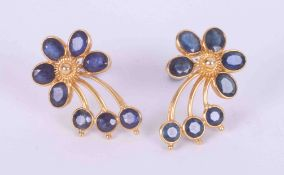 A pair of high carat (not tested) yellow gold flower earrings set with a mixture of oval and round