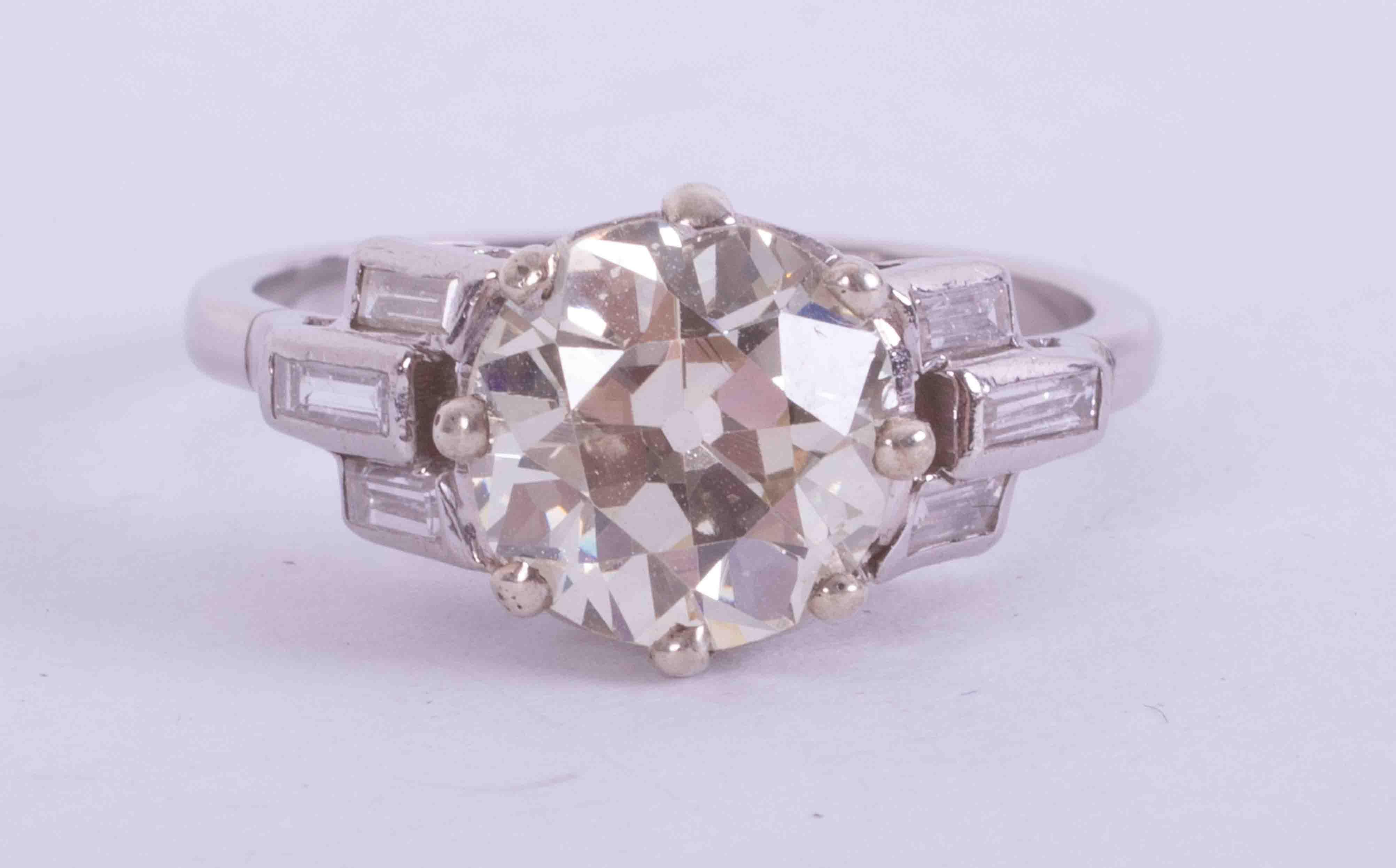 A fine platinum Art Deco ring set central round old cut diamond, approx. 2.43 carats, colour K-L &