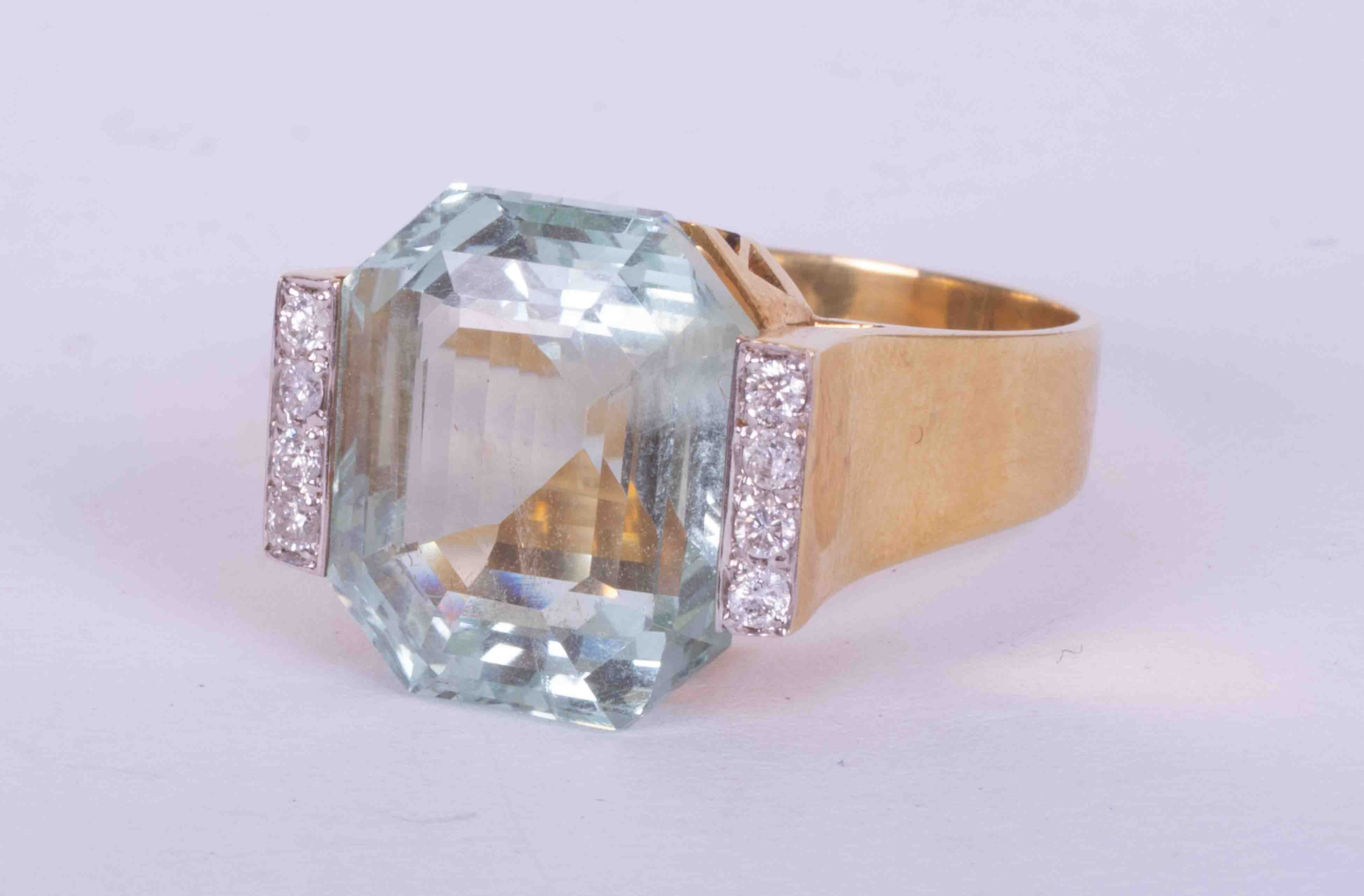 A 14ct yellow gold Art Deco style ring set approx. 11.26 carats of fancy cut Aquamarine with four