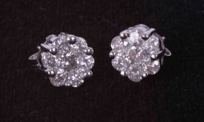 A pair of 9ct white gold flower cluster earrings set approx. 1.00 carats total weight of round