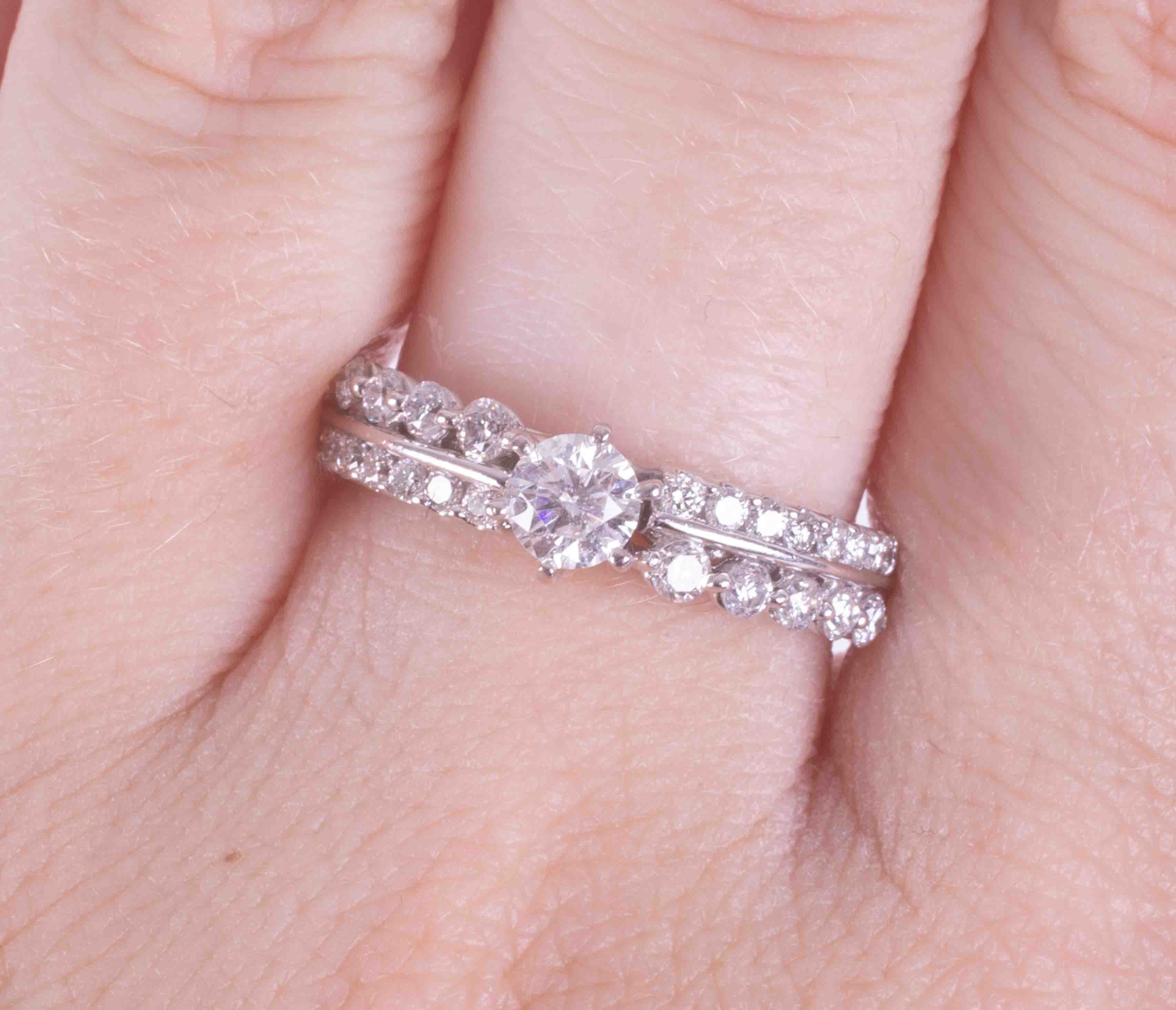 A 14k white gold ornate ring set with a double row of approx. 0.32 carats of round brilliant - Image 2 of 2