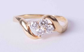 An 18ct yellow gold twist design ring set four round brilliant cut diamonds, approx. total weight