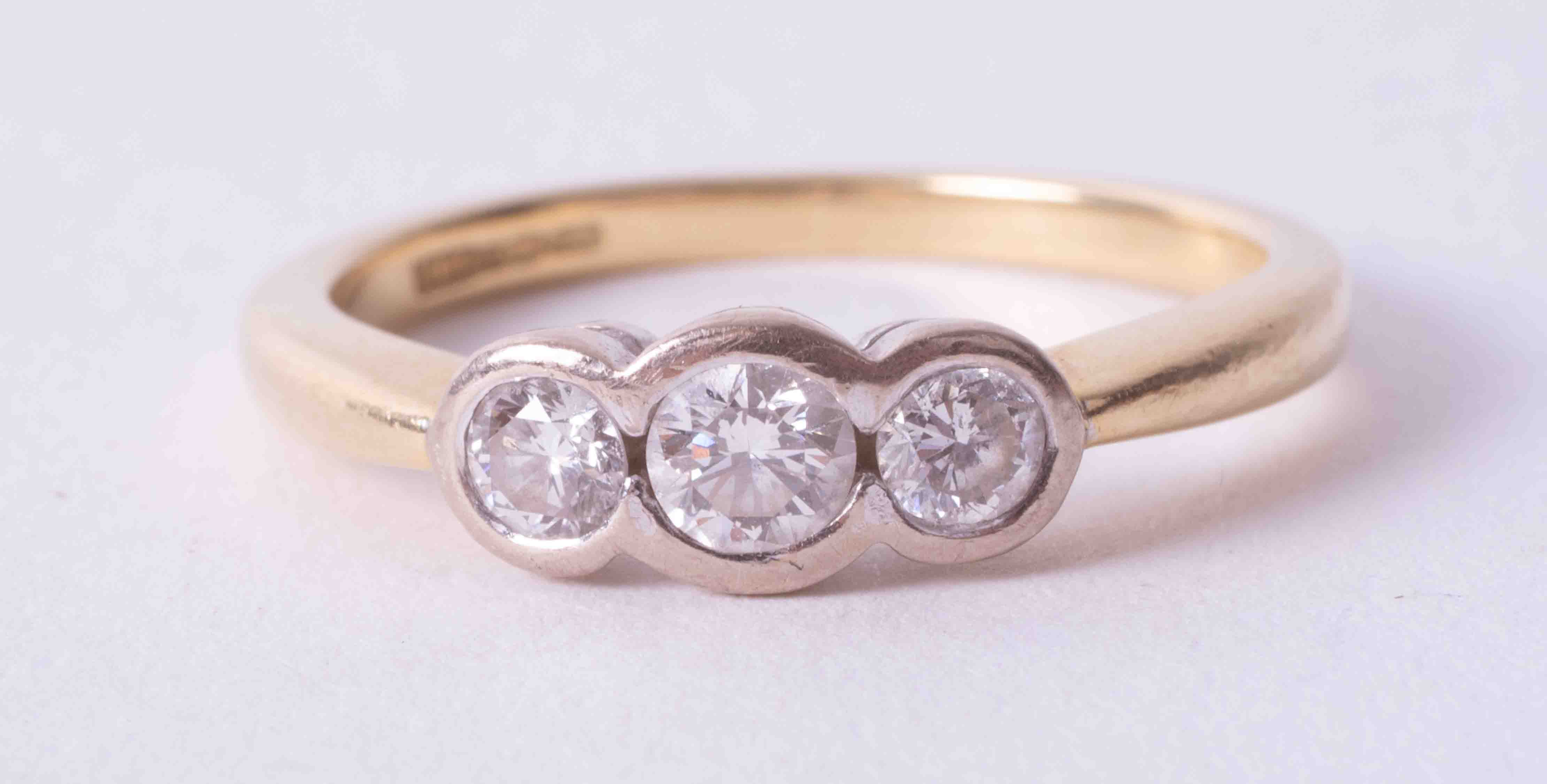 An 18ct yellow & white gold three stone ring set with approx. 0.37 carats total weight of