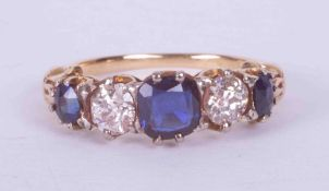 An antique 18ct yellow gold ornate five stone ring set approx. 0.80 carats total weight of oval