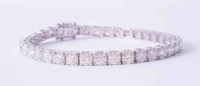 A fine 18ct white gold tennis bracelet set 37 round brilliant cut diamonds, approx. 11.60 carats,