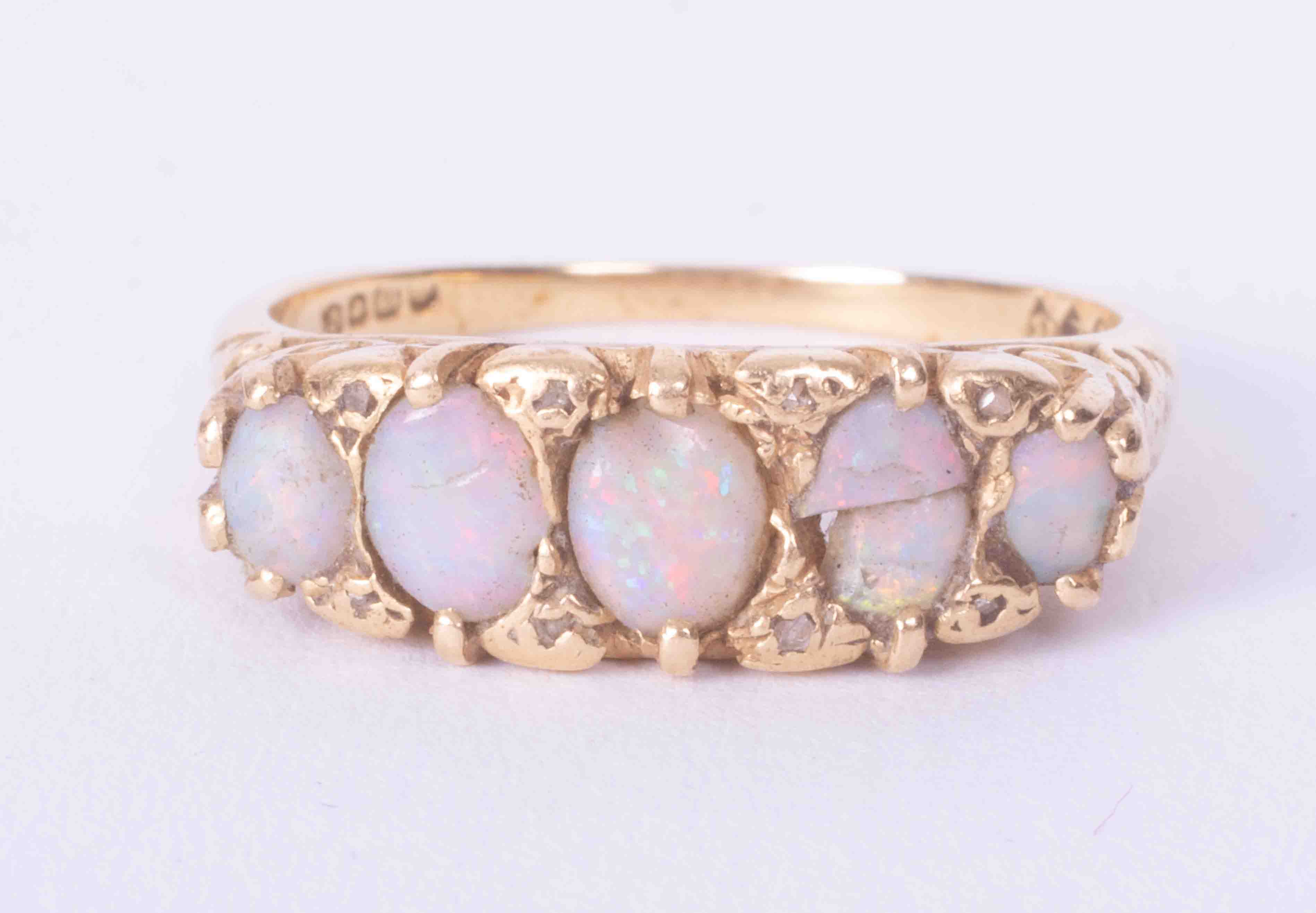 An antique 18ct yellow gold scroll design five stone opal ring (one opal broken and damage to