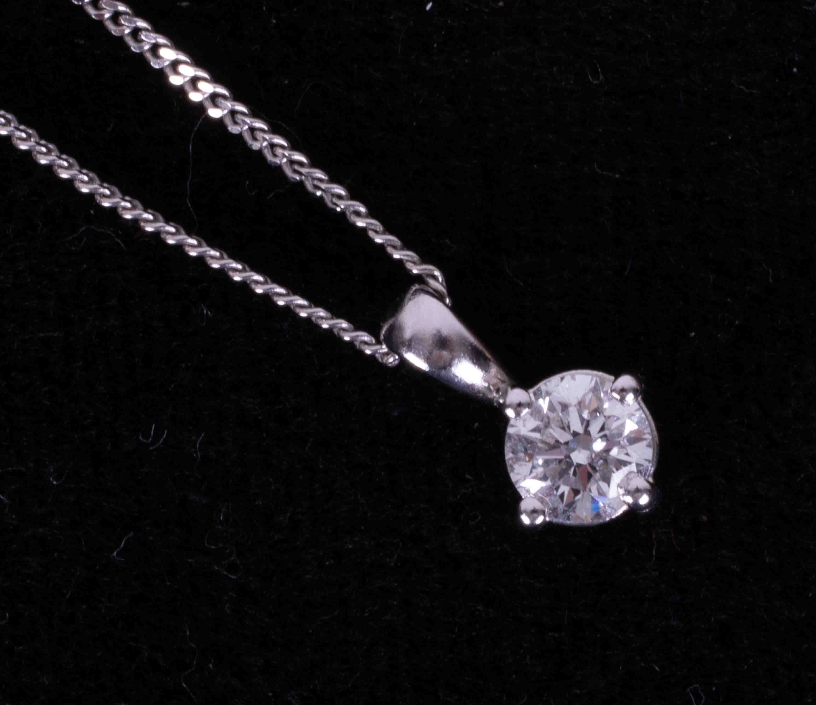 An 18ct white gold four claw pendant set approx. 0.40 carats of round brilliant cut diamond,