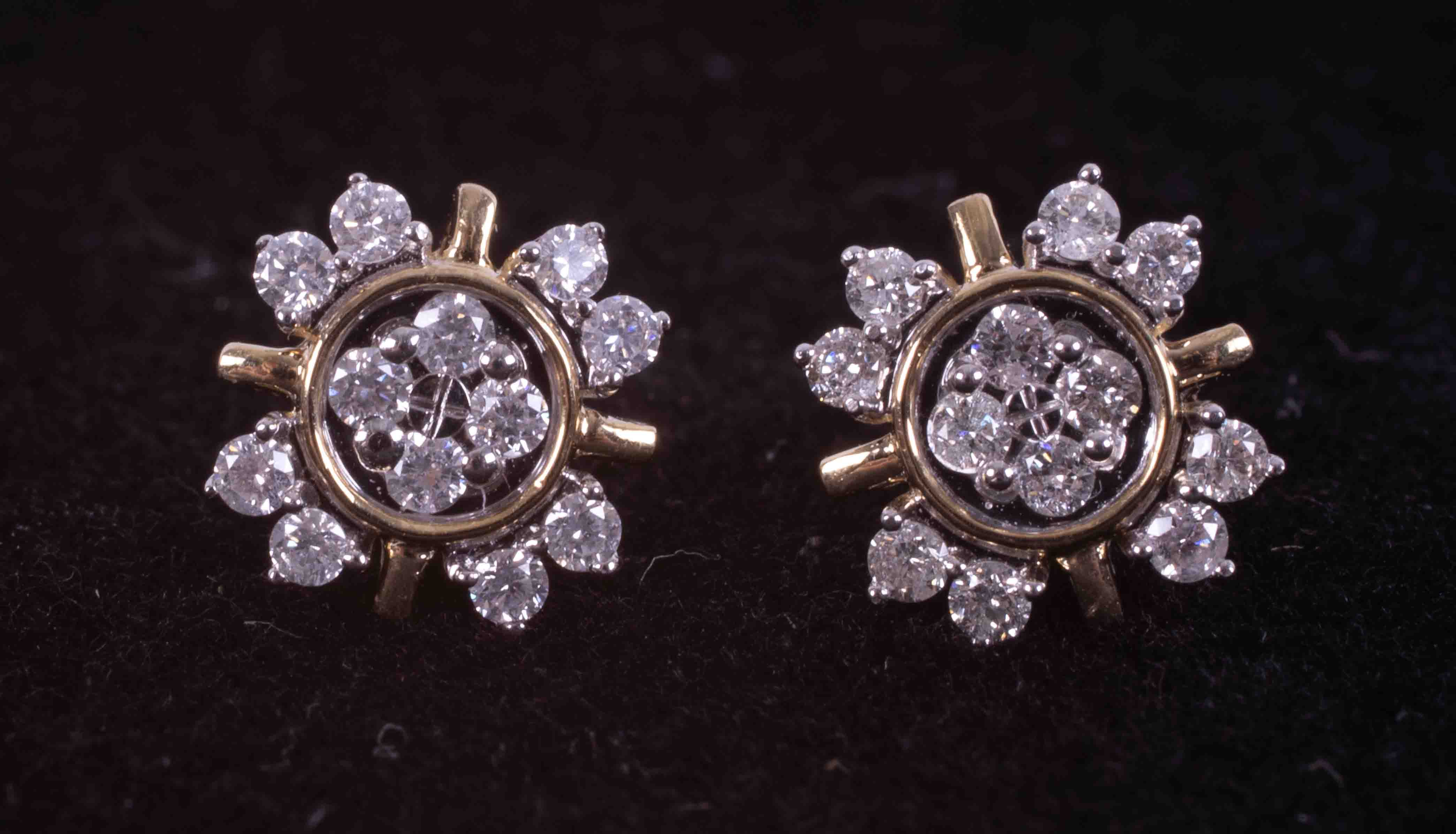 A pair of 9ct yellow gold flower design earrings set 0.34 carats (total weight) of round cut