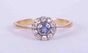 An antique 18ct yellow & white gold flower cluster ring set central sapphire approx. 0.21 carats,