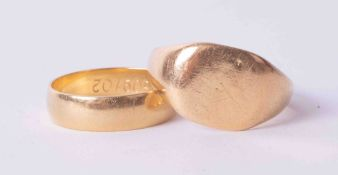Two 18ct yellow gold rings, one signet style ring, size S 1/2 & one band, size L 1/2, total weight