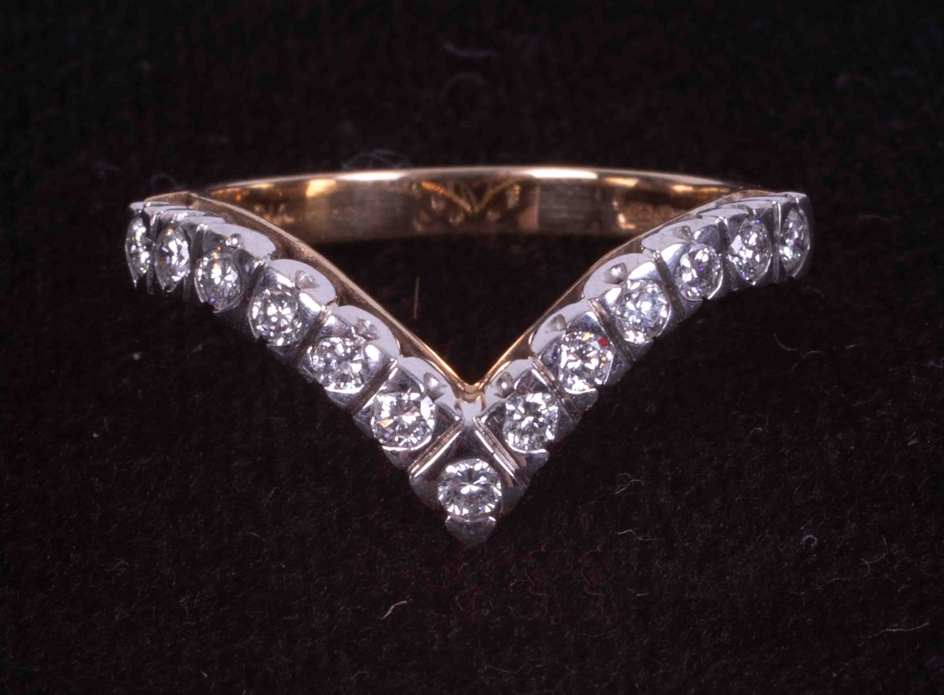 An 9ct yellow & white gold wishbone ring set with approximately 0.39 carats of round
