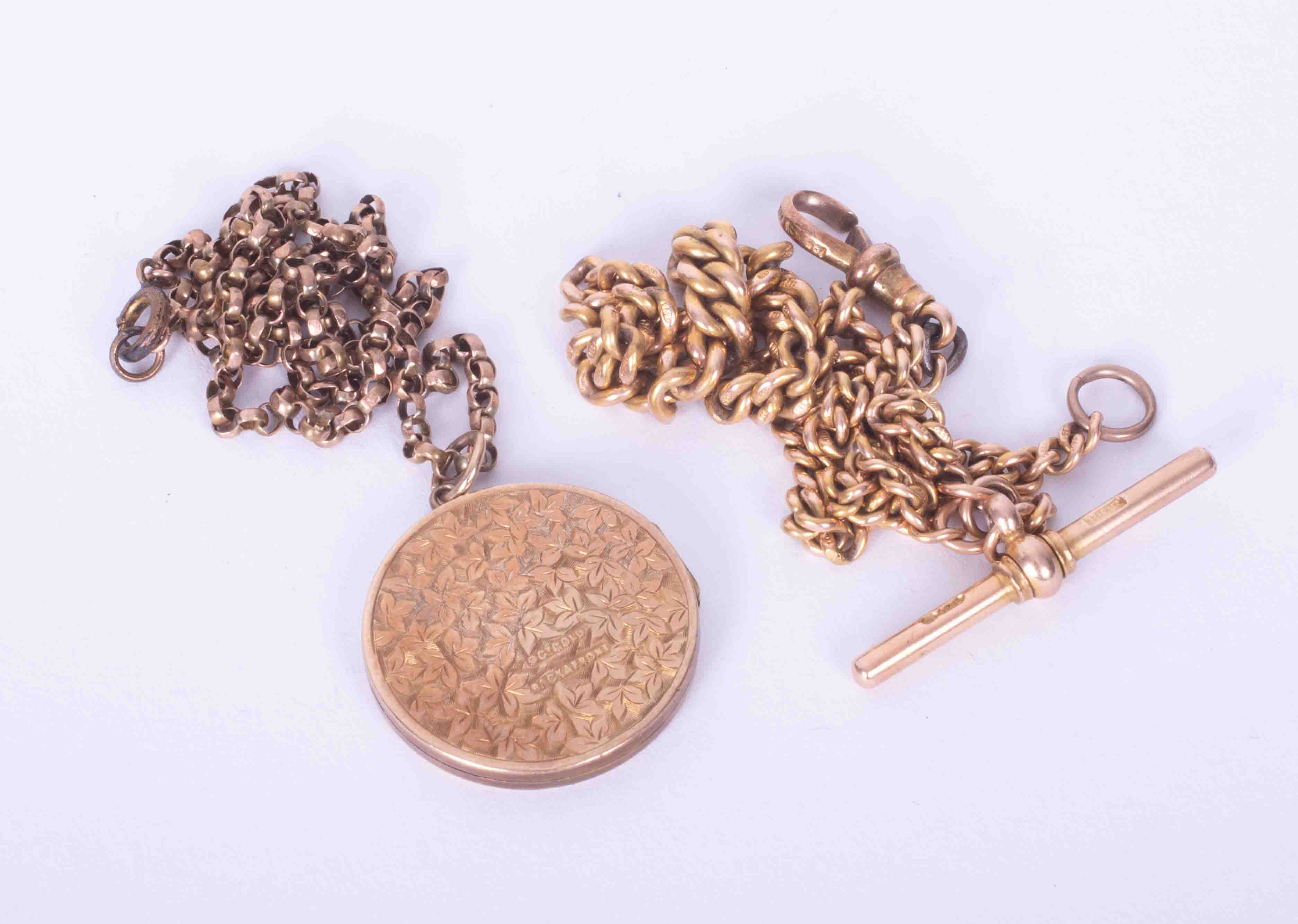 A 9ct yellow gold open link curb chain & 9ct yellow gold leaf design locket (weight 8.7g) and a 15ct