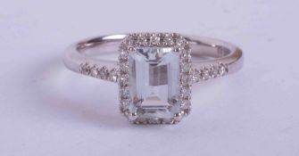 An 18ct white gold ring set central emerald cut Aquamarine approx. 1.00 carat in weight (7mm x 5mm),