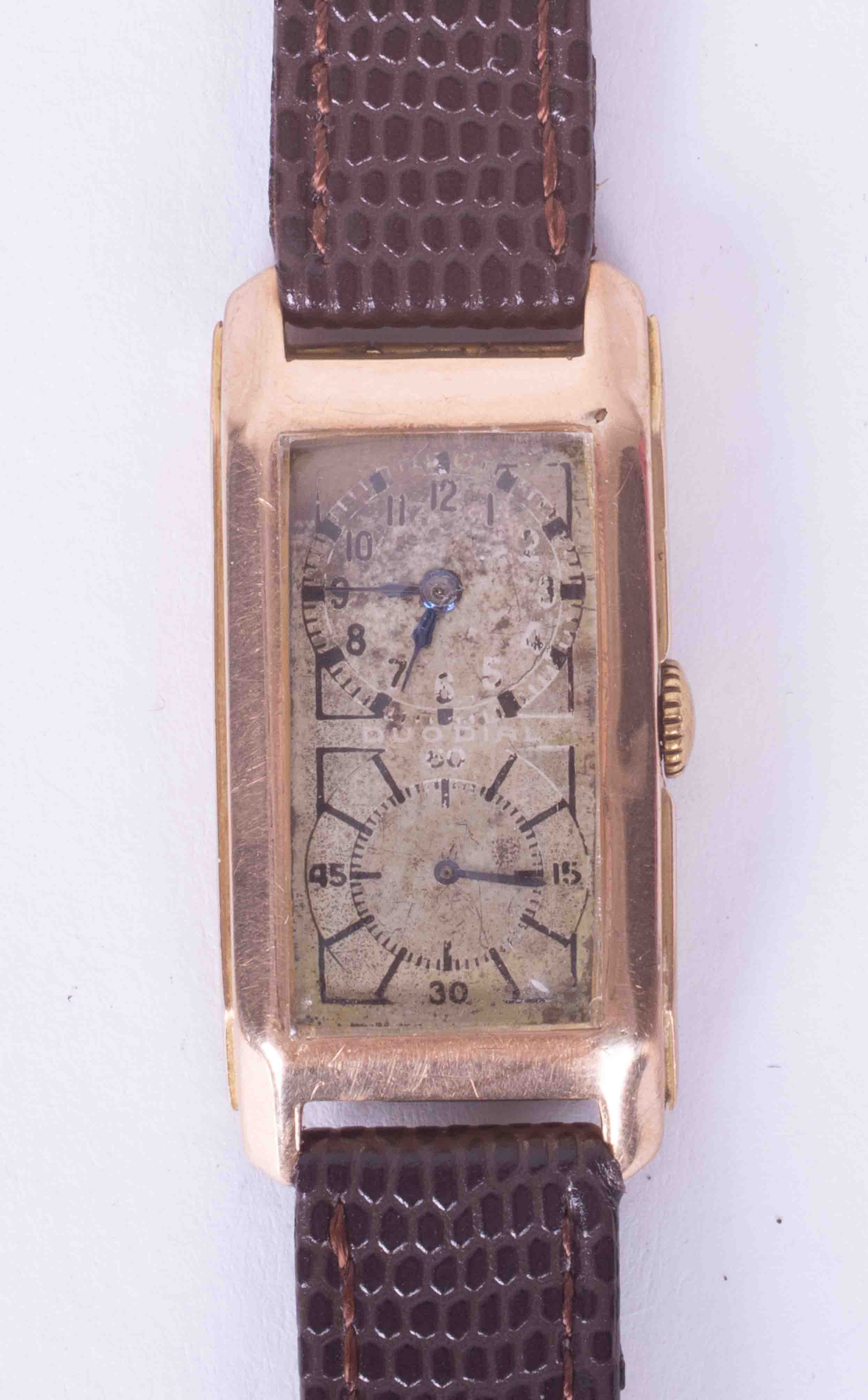 A 9ct yellow gold cased rectangular Doctors Duo Dial wristwatch. Classic Arabic top & large