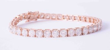 An impressive 18ct rose gold (stamped 18k) tennis bracelet set 39 round brilliant cut diamonds,