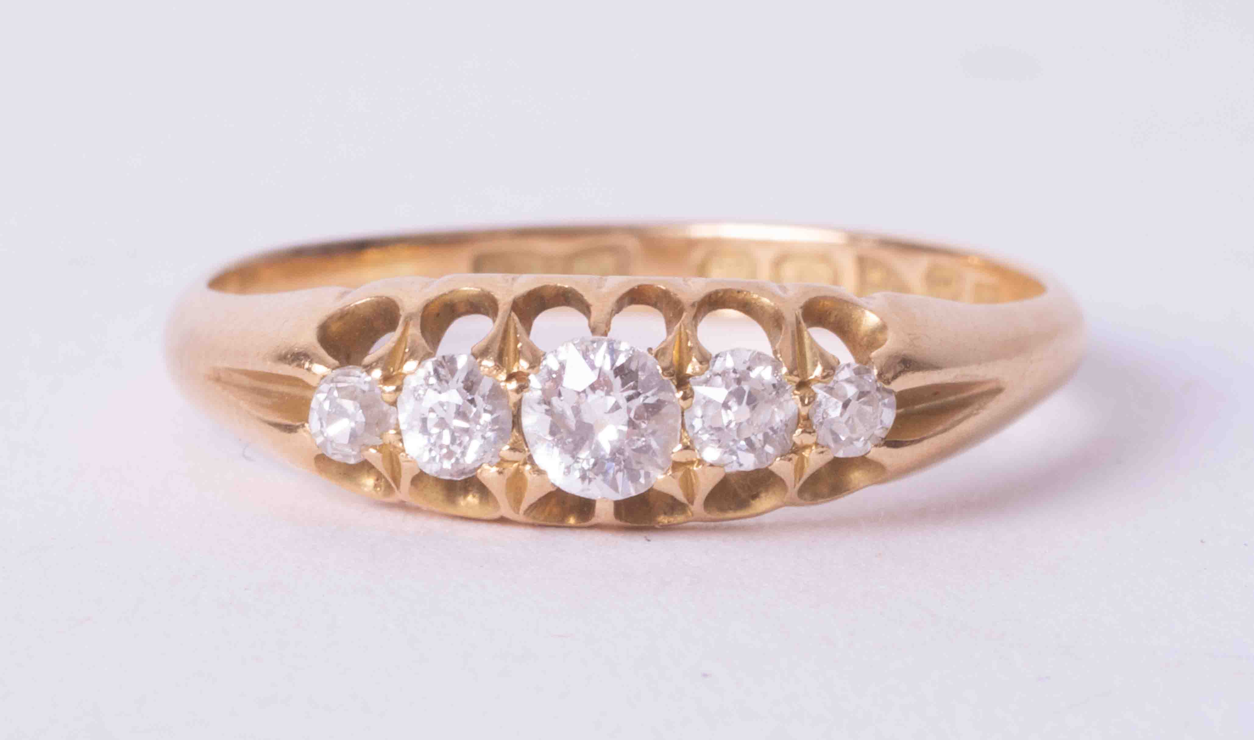 An antique 18ct yellow gold five stone ring set with approx. 0.35 carats of old round cut
