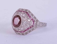 """A platinum Art Deco style ring set central oval cut ruby, 1.17 carats, colour vivid red """"Pigeon"""