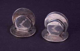 A pair of Edwardian silver menu/place holders, circular double disc design, engraved crest on