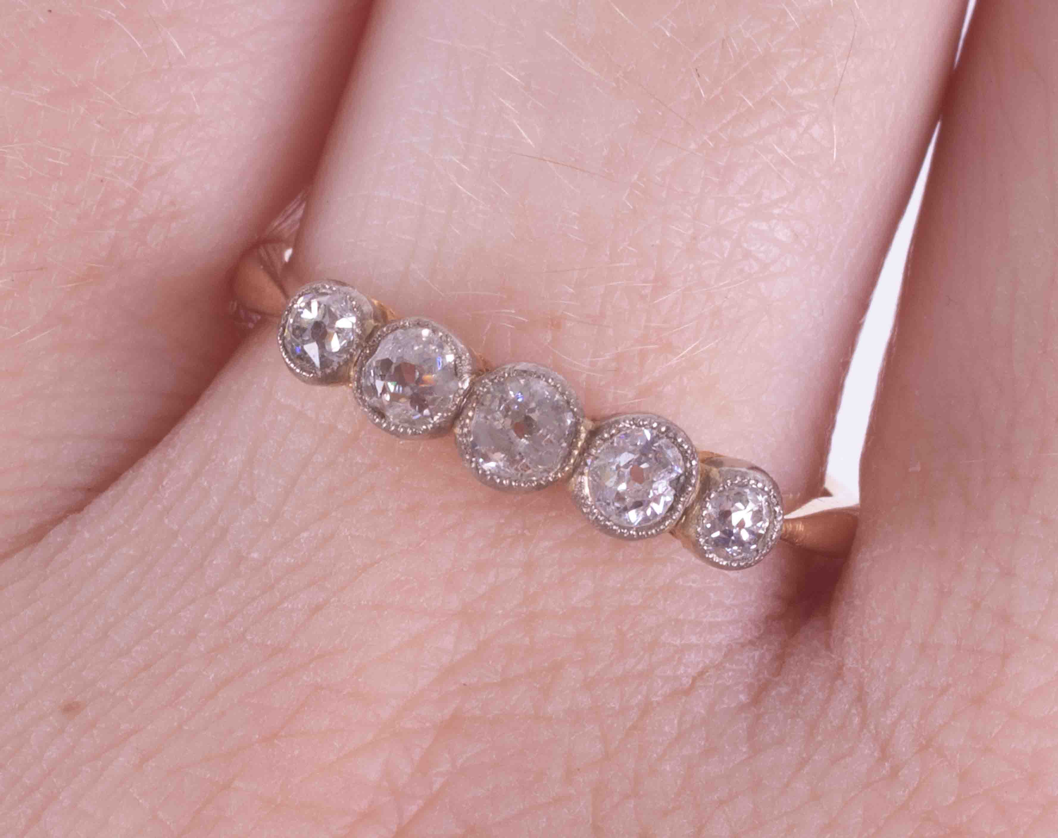 An 18ct yellow gold five stone ring set with approx. 0.79 carats of old round cut diamonds, 2.84g, - Image 2 of 2