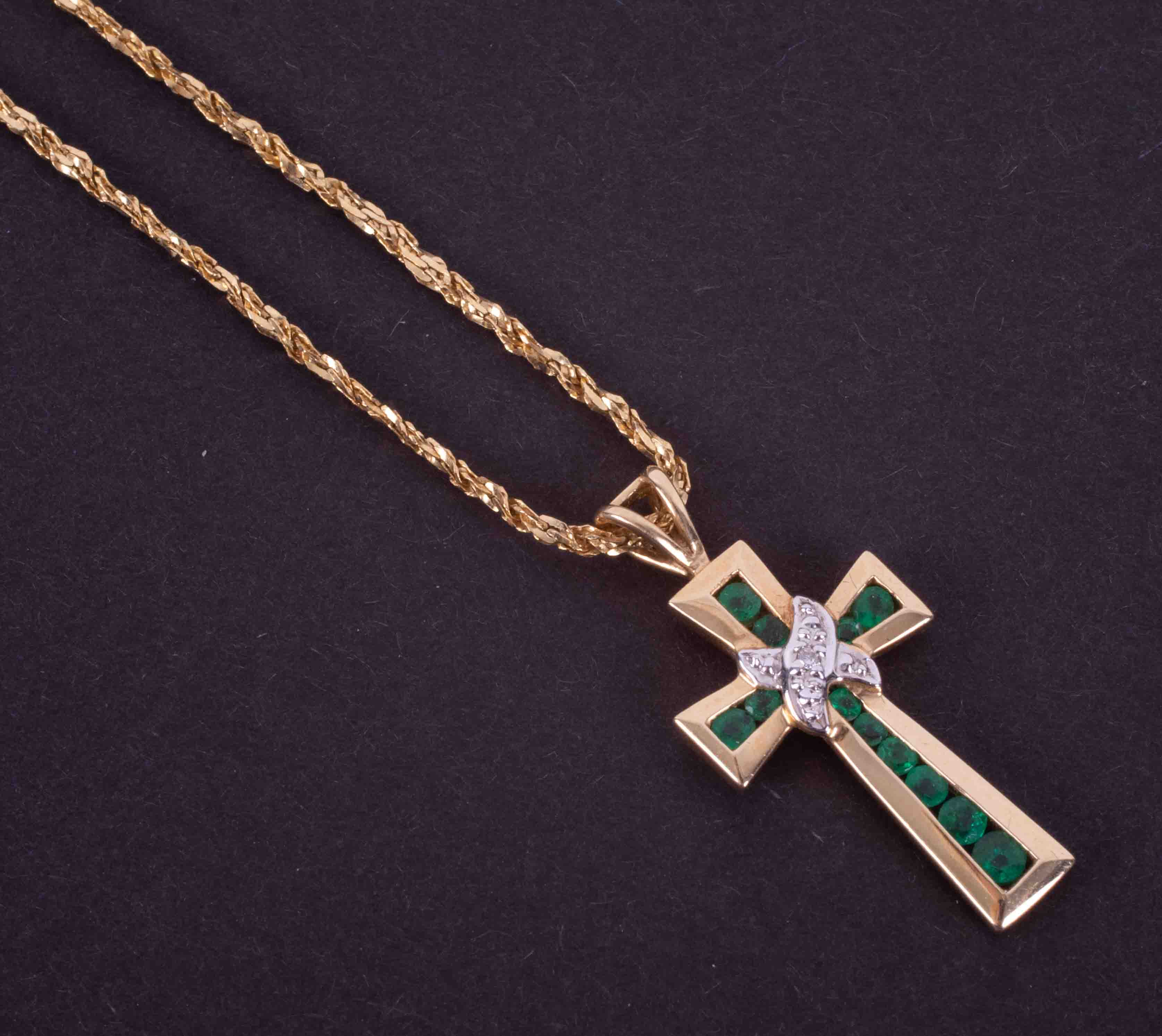"""A 14ct yellow gold 16"""" fancy chain with a 14ct yellow & white gold cross pendant set with round"""
