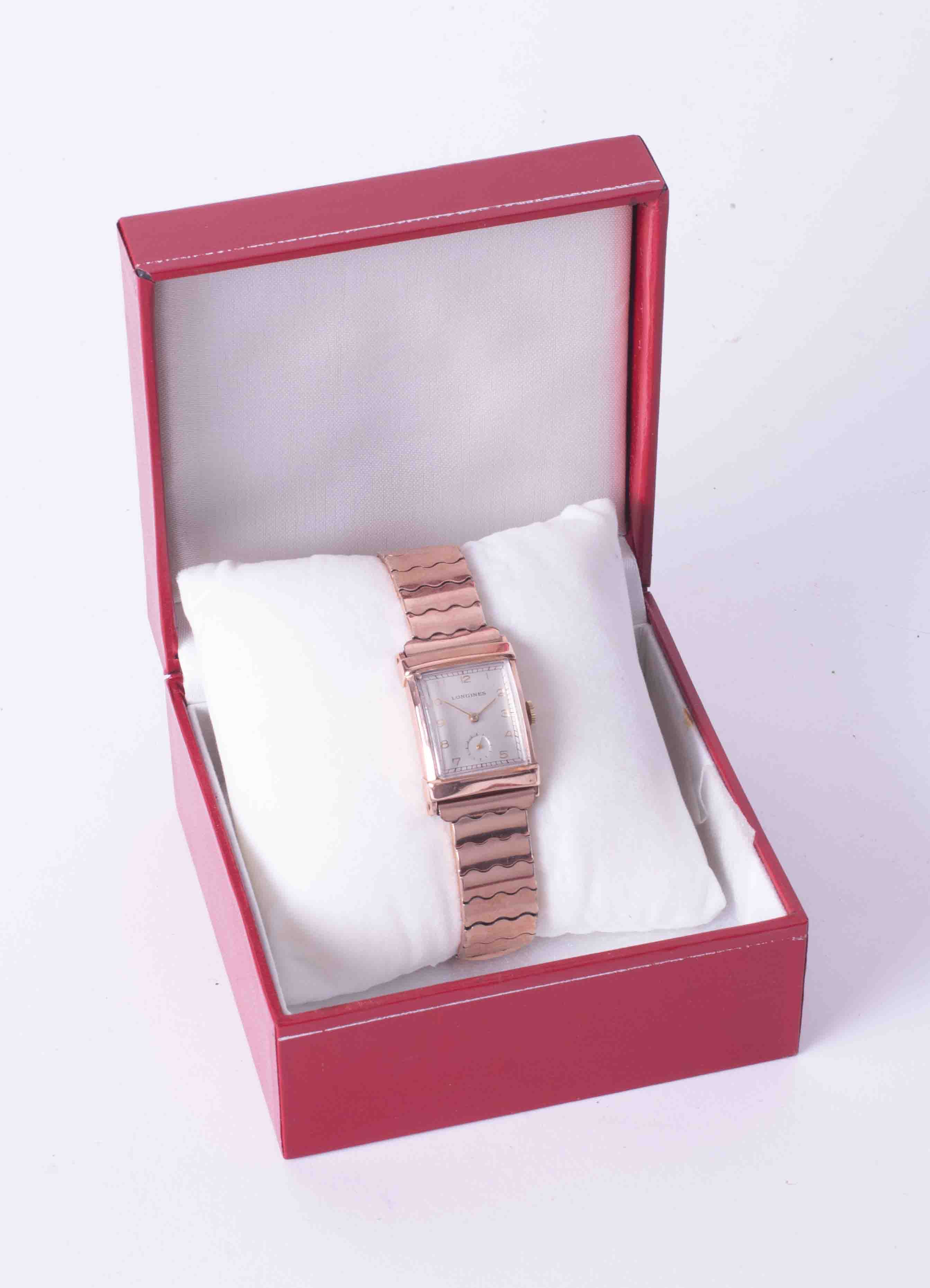 Longines, a gents mid size rectangular cased rose colour (gold filed) wristwatch, integral expanding - Image 2 of 2