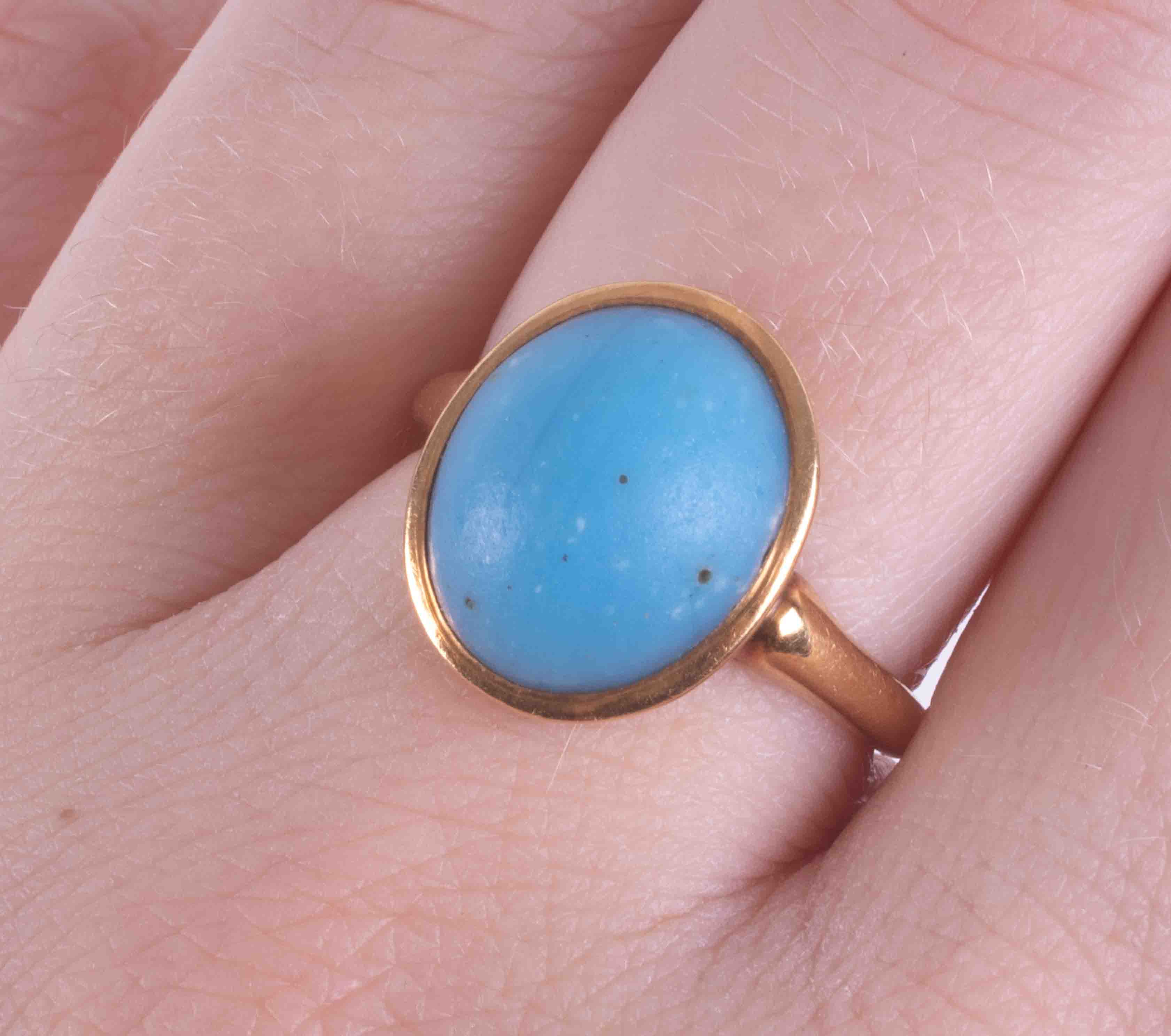 An 18ct yellow gold ring set with an oval cabochon cut turquoise measuring approx. 12.7mm x 11mm, - Image 2 of 2
