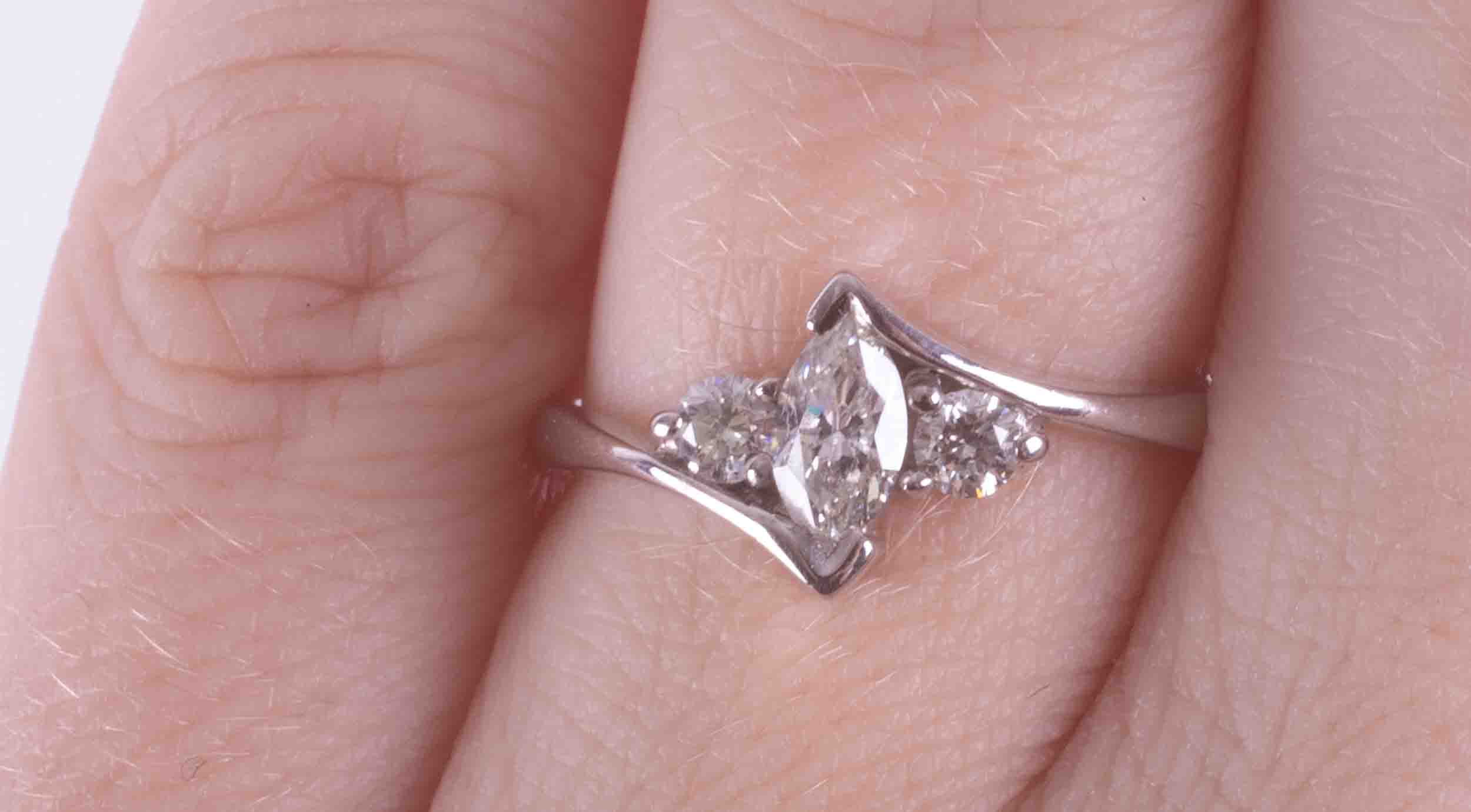 An 18ct white gold cross over style ring set with a central marquise cut diamond, approx. 0.27 - Image 2 of 2
