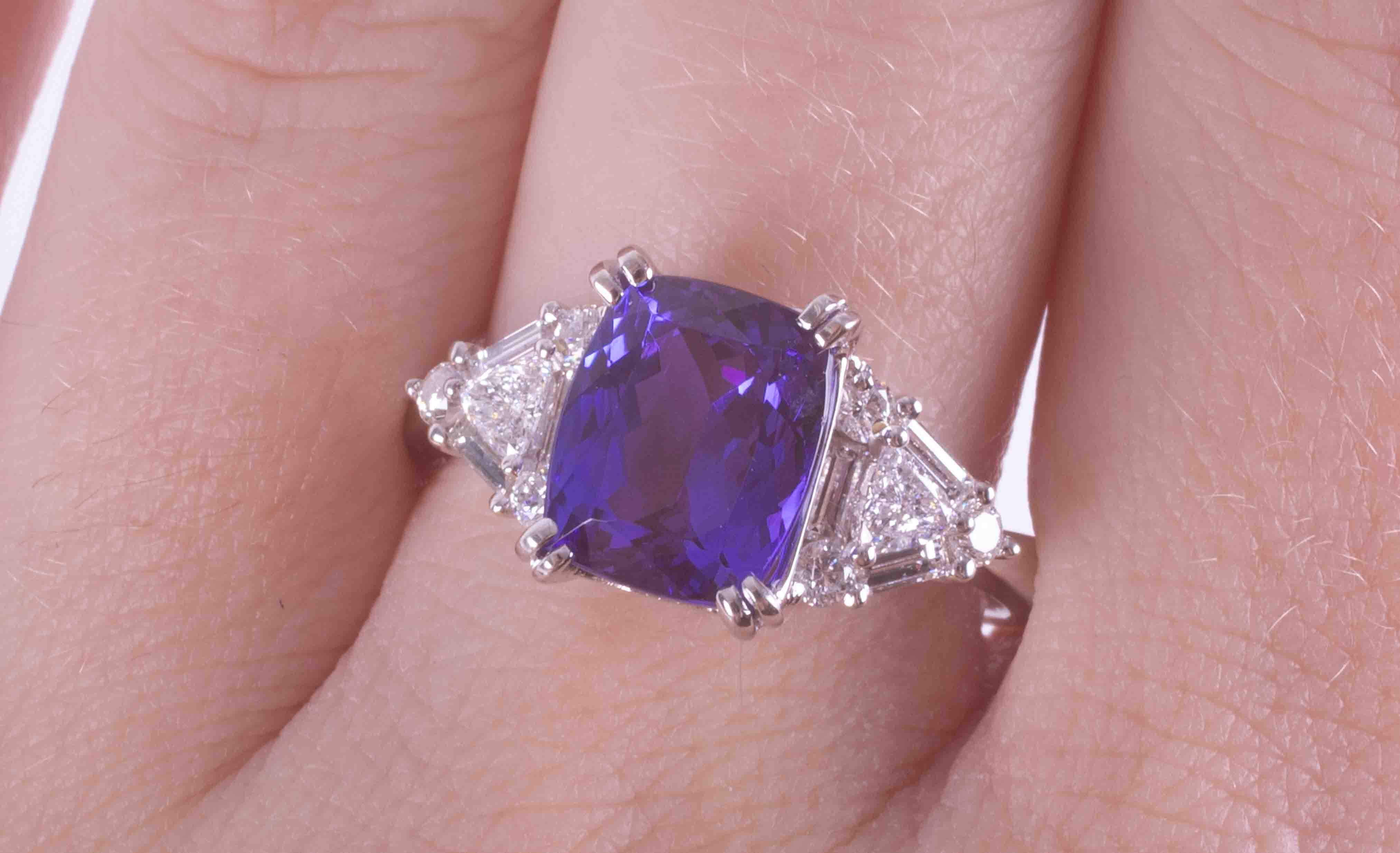 An impressive 18ct white gold ring set with a central cushion cut Tanzanite approx. 3.35 carats, AAA - Image 2 of 3