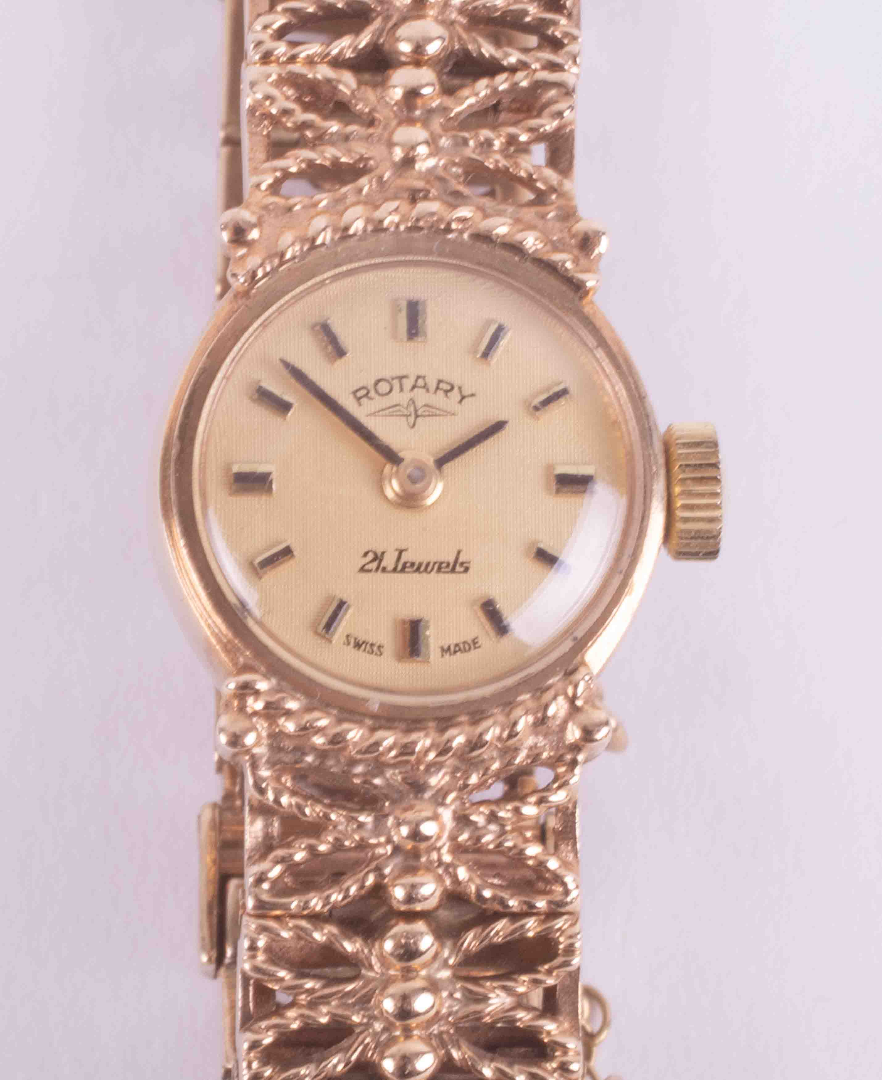 Rotary, a ladies vintage 9ct yellow gold wristwatch with a fancy link bracelet with a semi-hidden