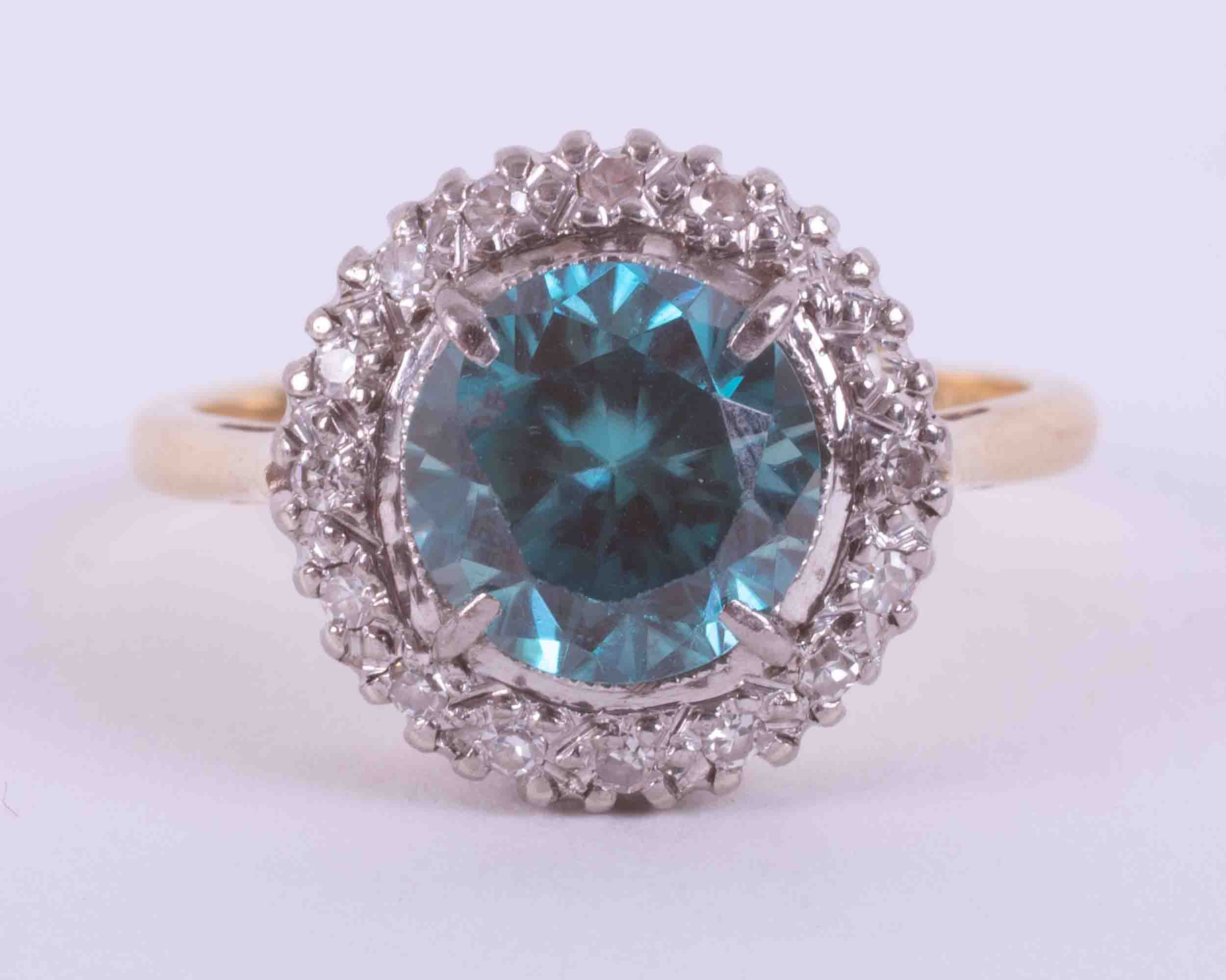 An 18ct yellow gold & platinum cluster ring set with approx. 1.67 carats of blue zircon surrounded