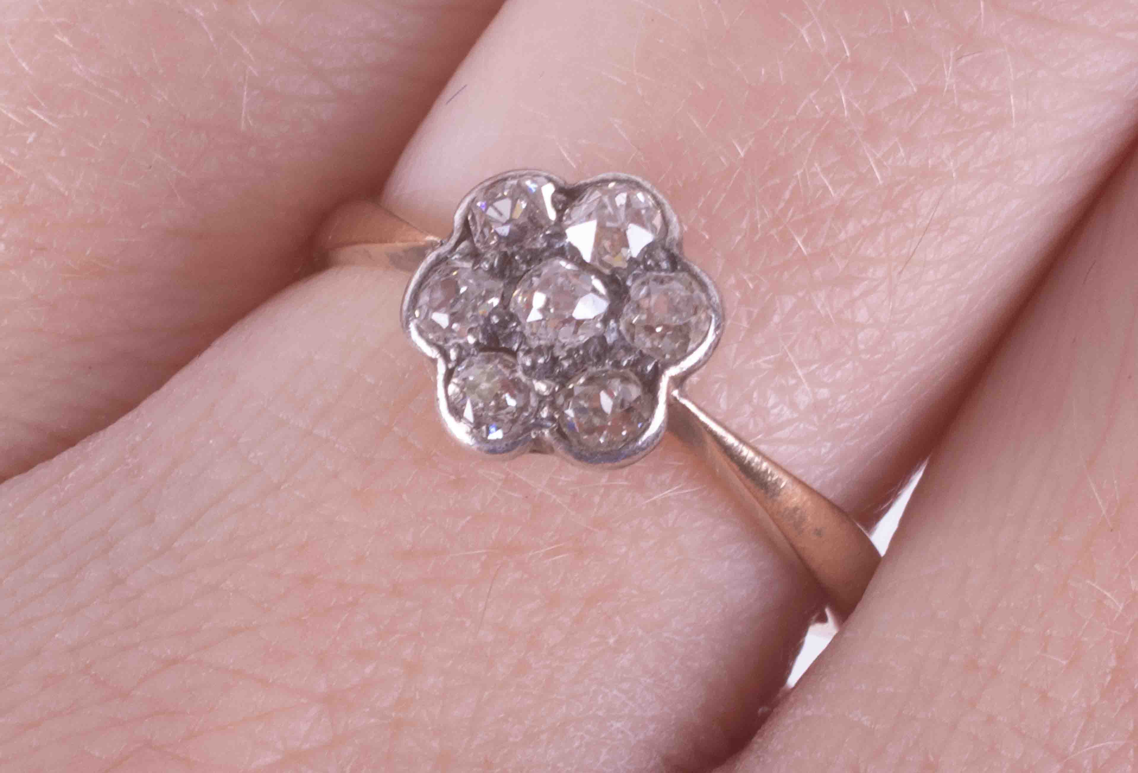 An 18ct yellow & white gold flower cluster ring set with seven old round cut diamonds, approx. total - Image 2 of 2