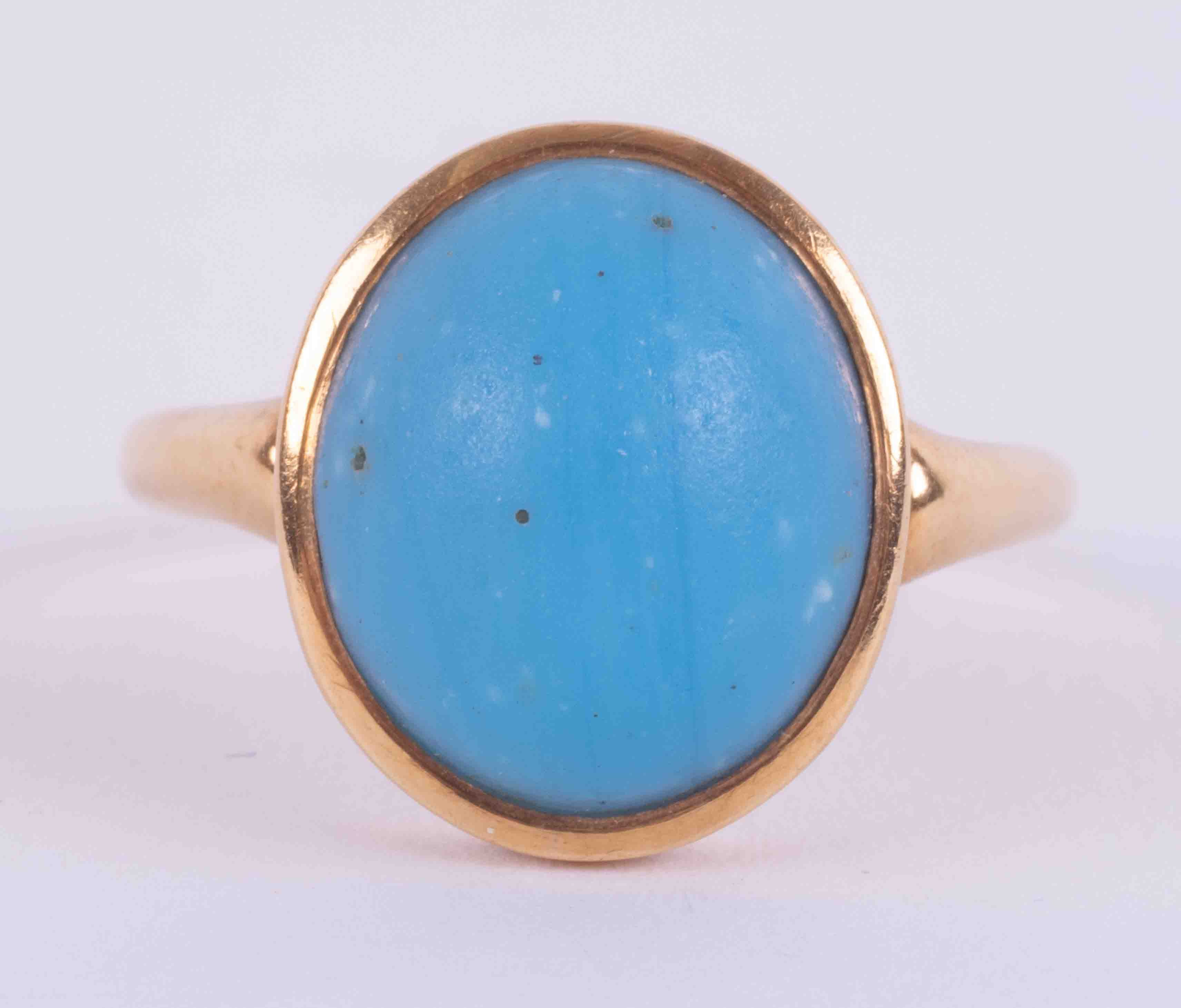 An 18ct yellow gold ring set with an oval cabochon cut turquoise measuring approx. 12.7mm x 11mm,