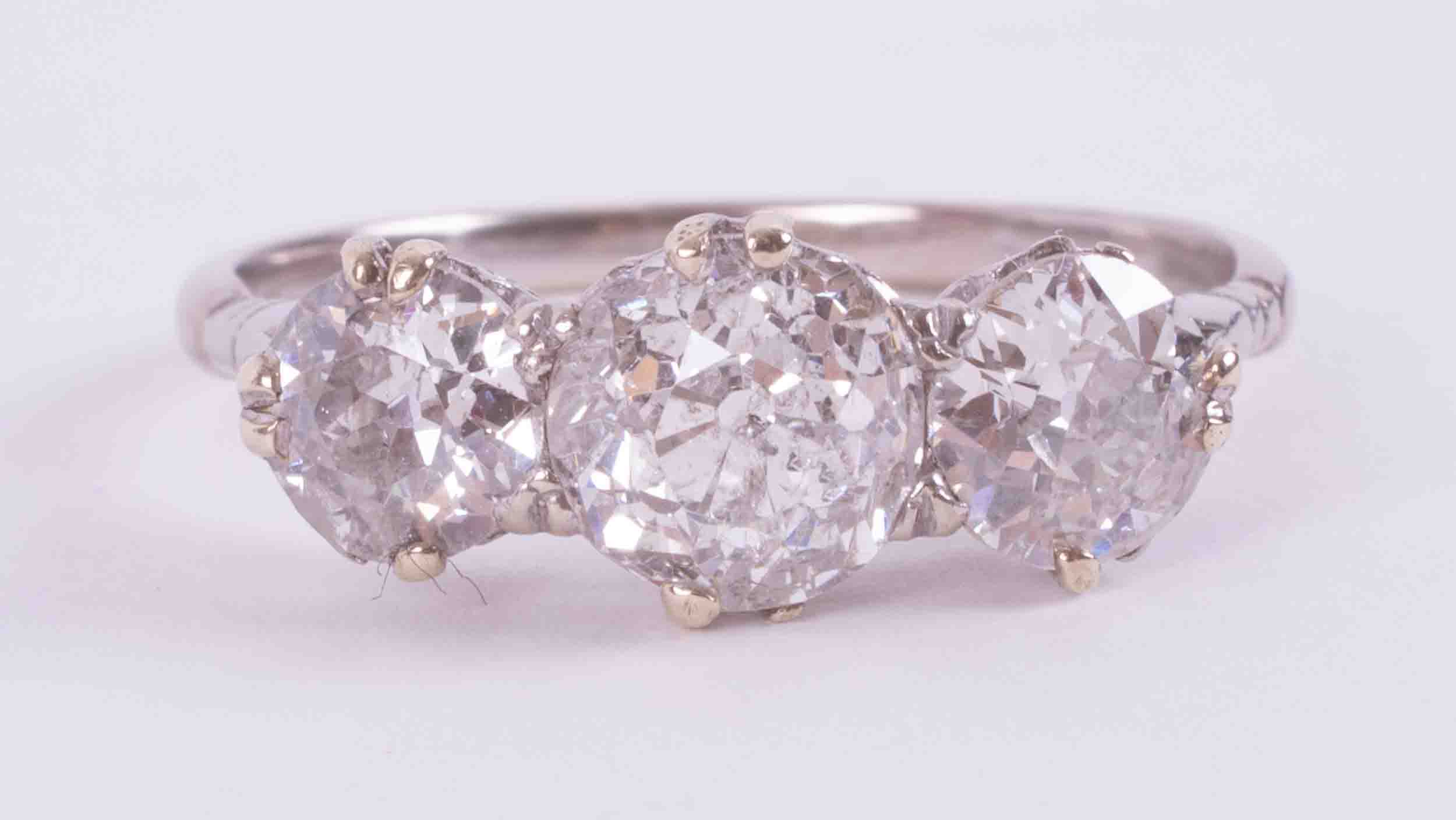 An impressive 18ct white & yellow gold three stone ring set with approx. 3.37 carats total weight of
