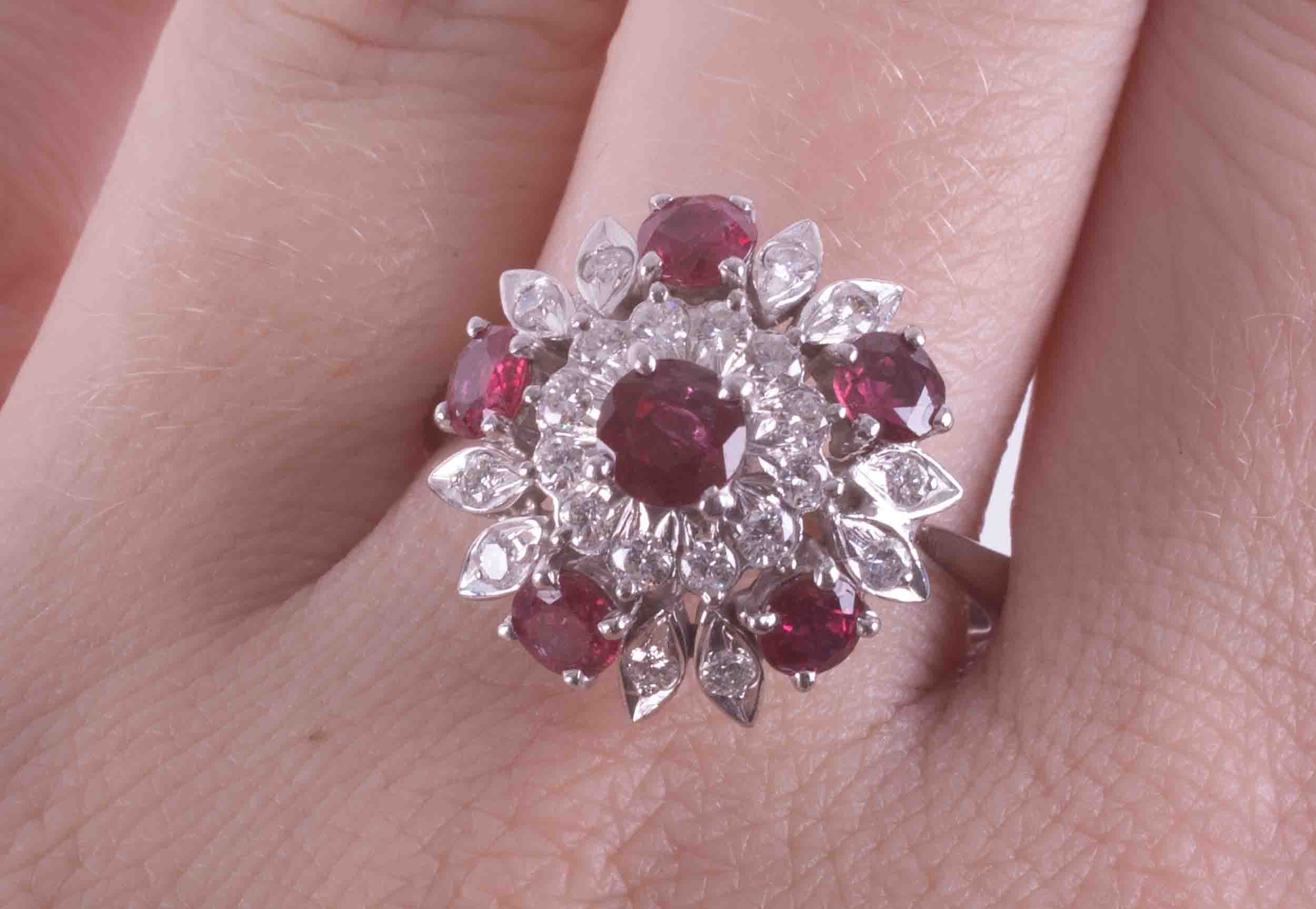 A 14ct white gold flower design cluster ring set with approx. 1.75 carats of round cut rubies - Image 2 of 2