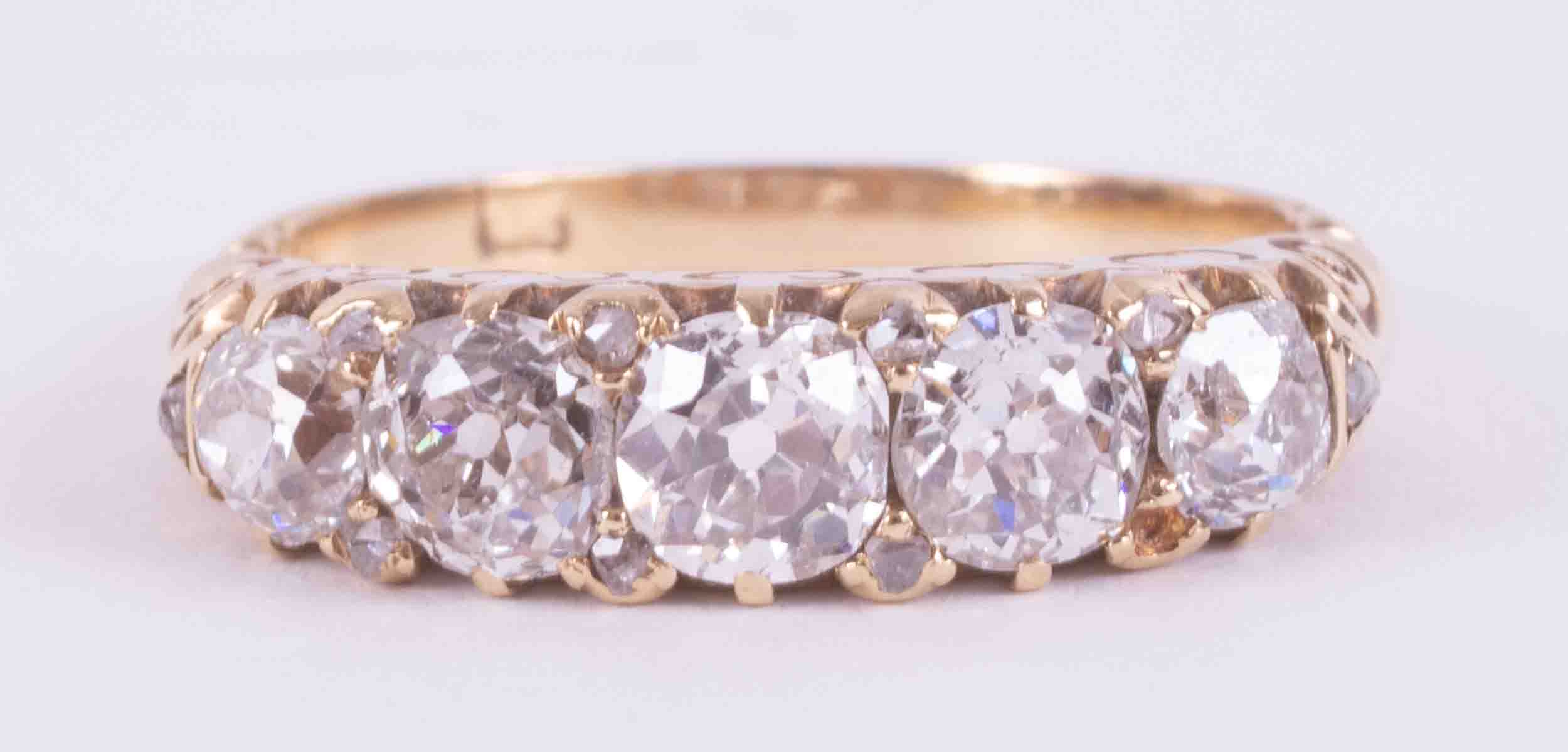 A Victorian 18ct yellow gold ring set with five old round cut diamonds, total weight approx. 1.58