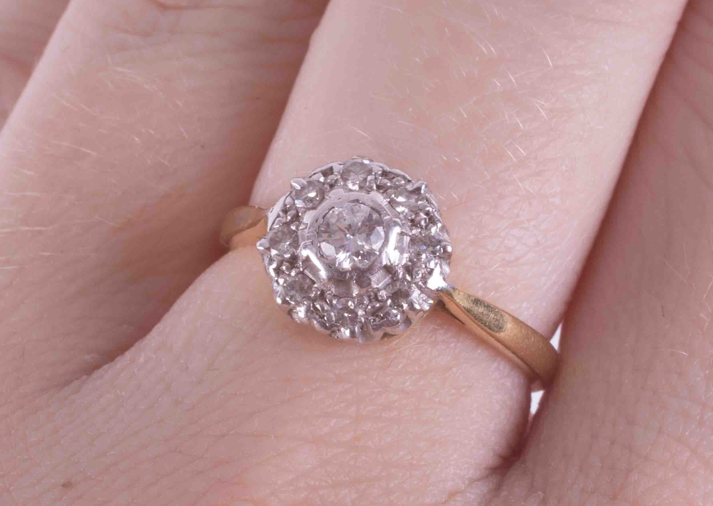 An 18ct yellow & white gold flower style cluster ring set with approx. 0.15 carats of round cut - Image 2 of 2