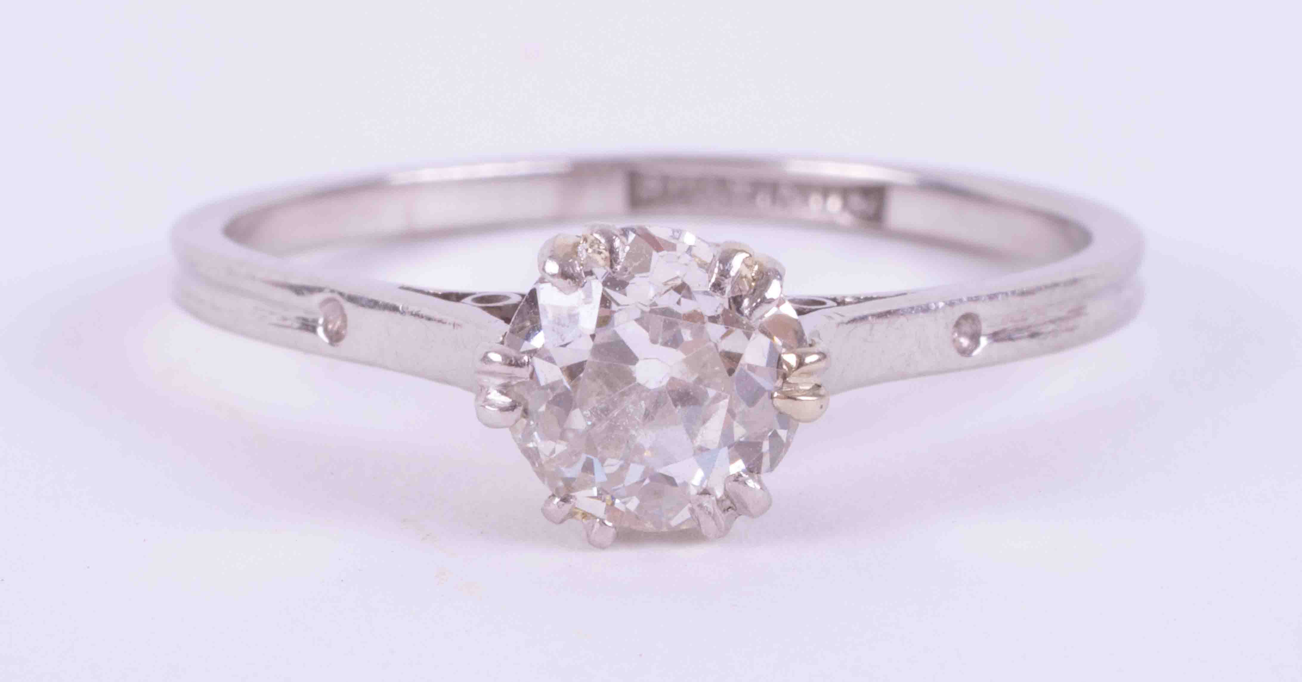 A platinum single stone ring with set with approx. 0.81 carats of old round cut diamond, colour H-