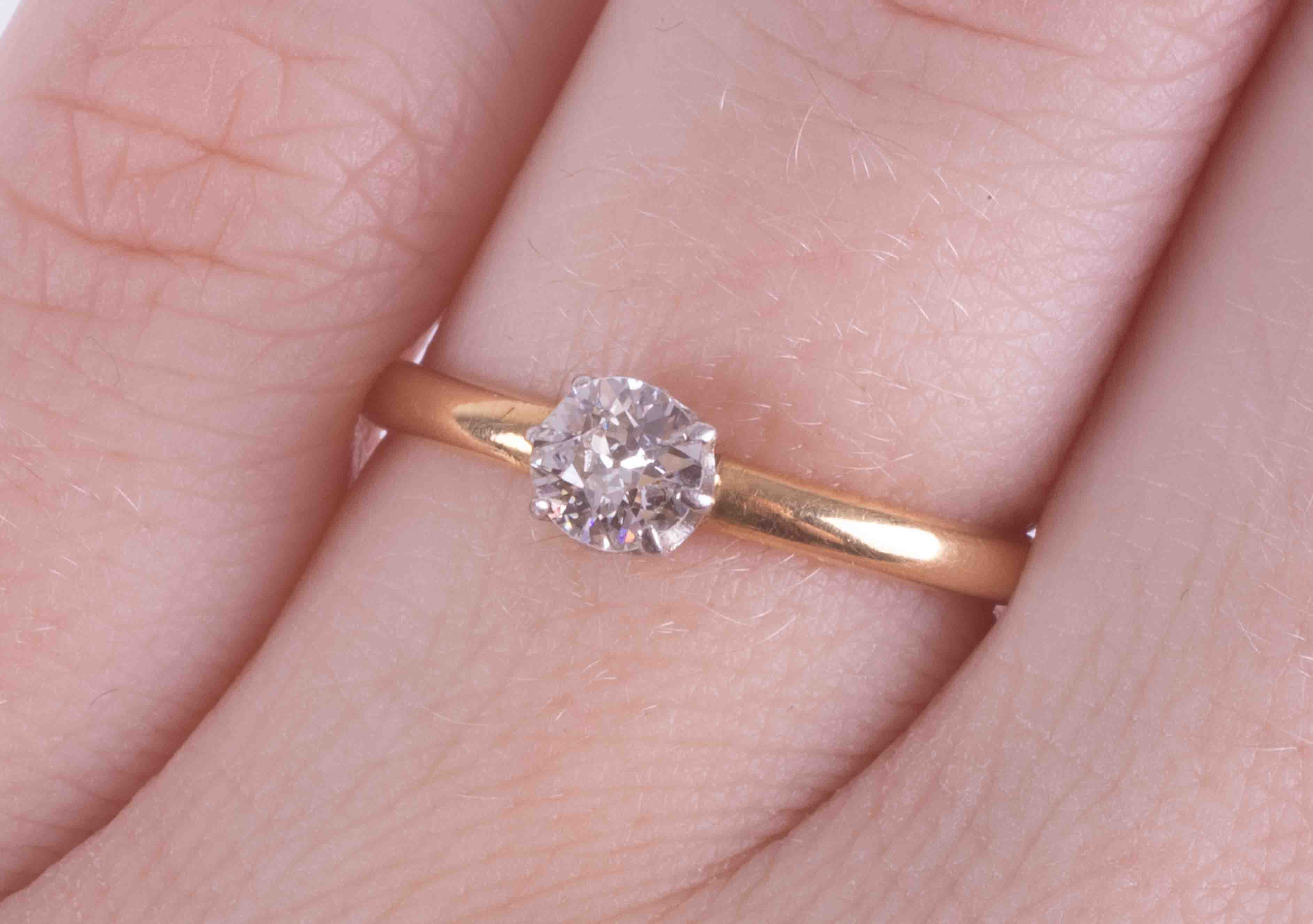 An 18ct yellow & white gold (no hallmarks and not tested) solitaire ring set with an older cut round - Image 2 of 2