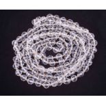 """A 60"""" faceted crystal bead necklace, knotted, approx. 122.56g."""