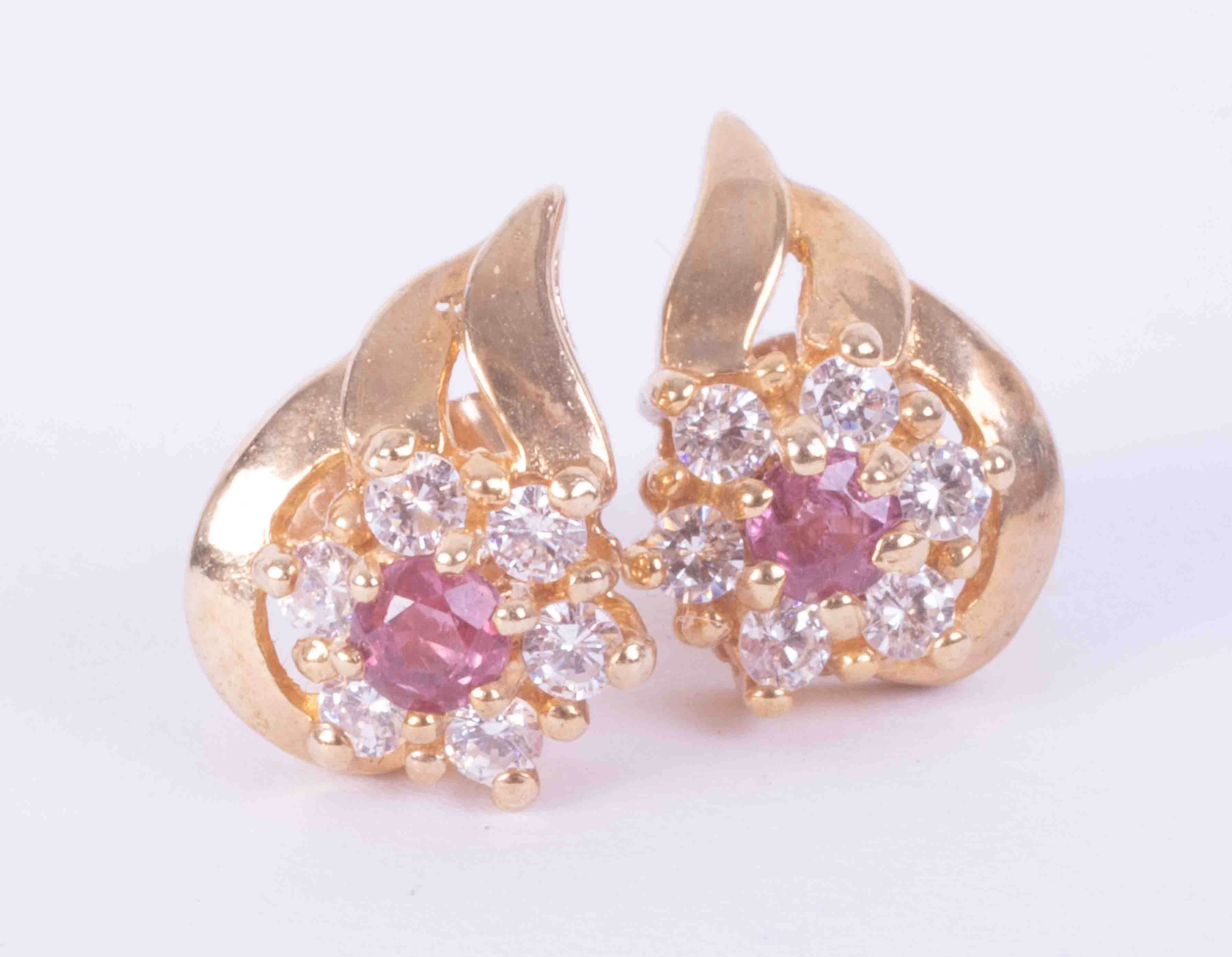 A pair of 9ct yellow gold leaf & flower design earrings set approx. 0.12 carats of ruby (total