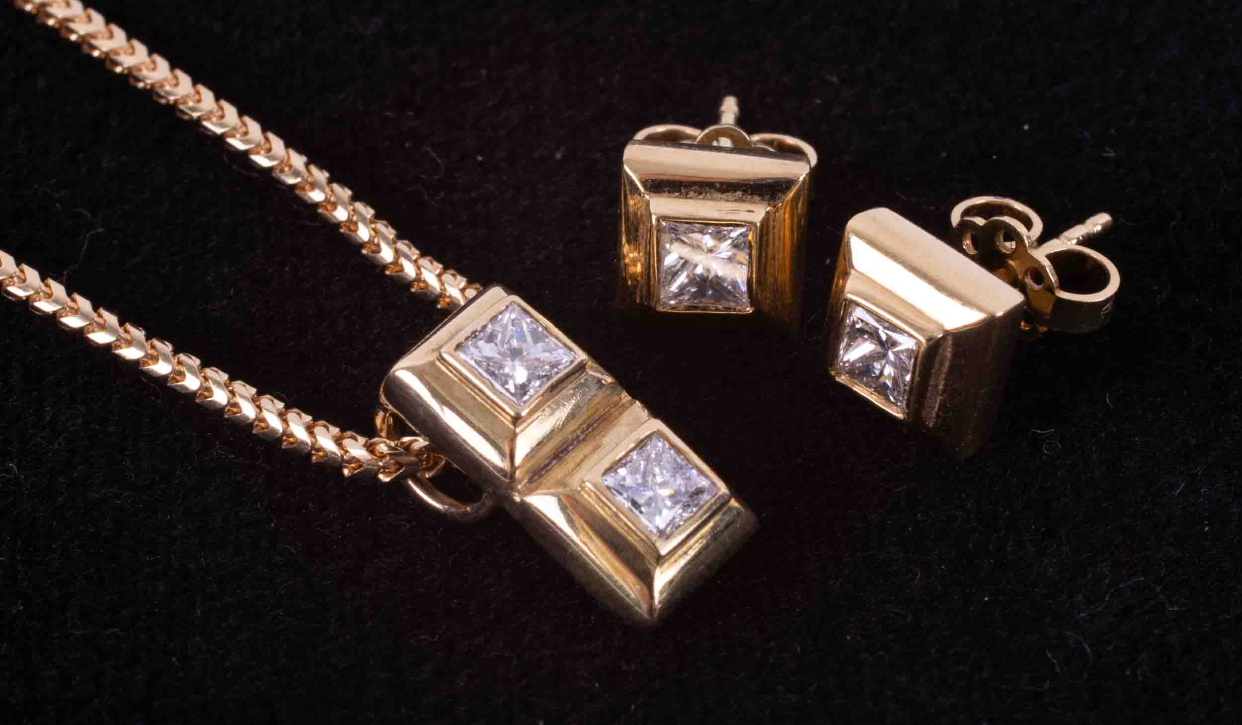 A jewellery suite comprising of a pair of 18ct yellow gold square shaped stud earrings set with