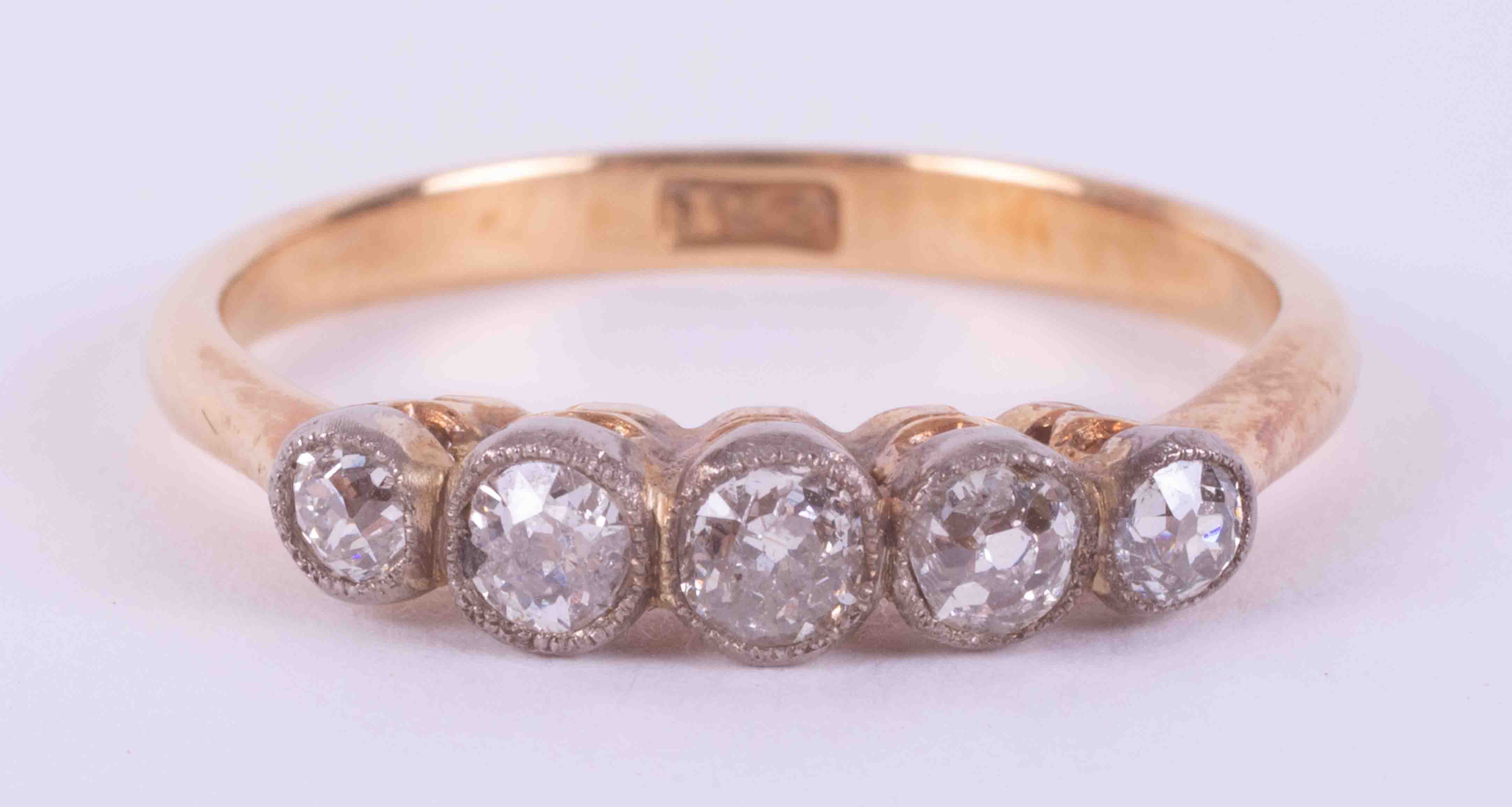 An 18ct yellow gold five stone ring set with approx. 0.79 carats of old round cut diamonds, 2.84g,
