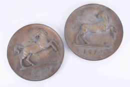 A pair of heavy bronze historical Lloyds Bank circular wall plaques, depicting the horse logo with a