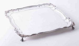 Large square silver plated salver in good condition, plain body with bead decoration and shell