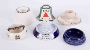 A collection of seven pub ashtrays including Watson Blue Band, Doulton Bass in a bottle, Shelly