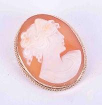 A 9ct gold cameo brooch set with double twist wire decoration.